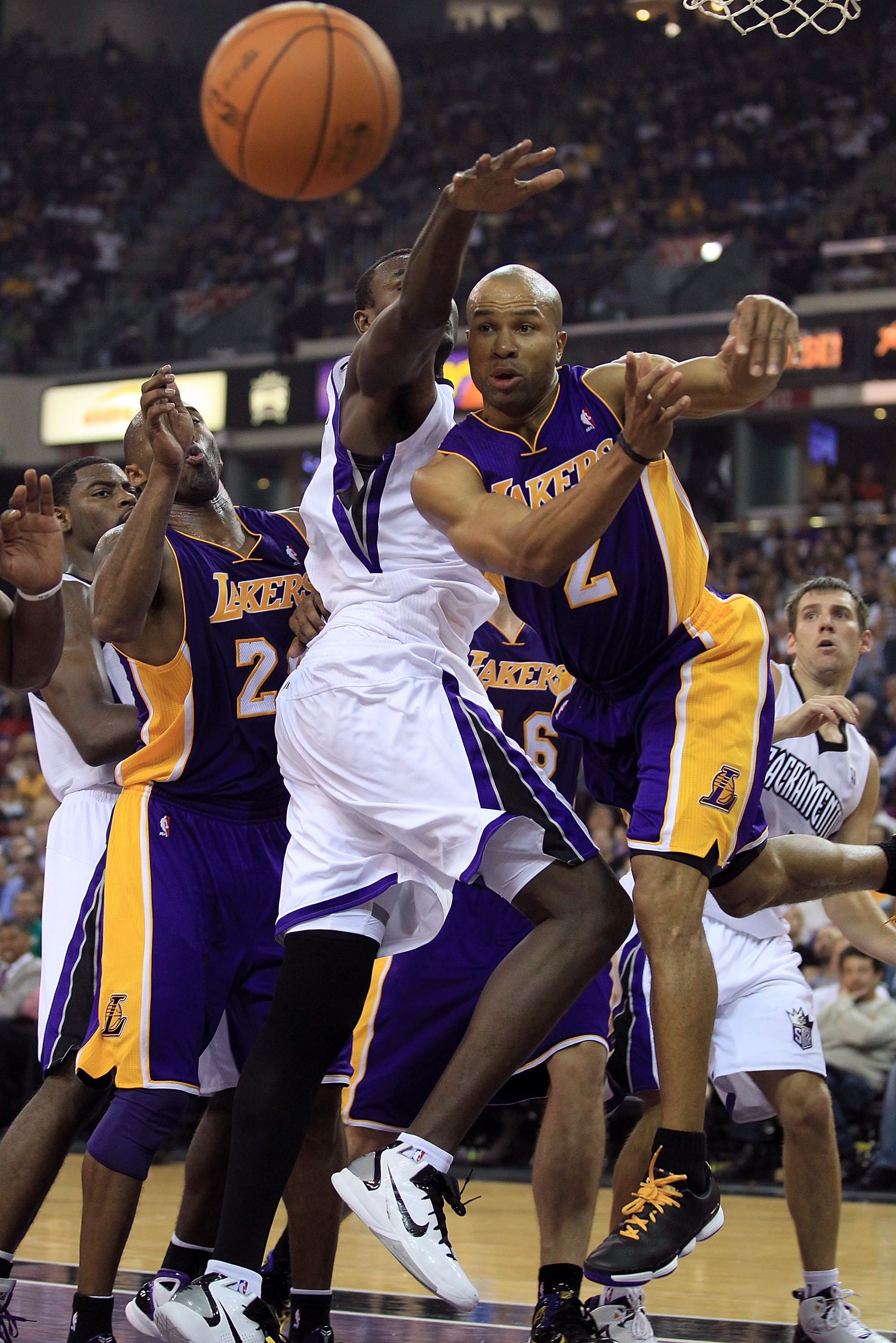 SACRAMENTO, CA - NOVEMBER 03: Derek Fisher #2 of the Los Angeles Lakers passes the ball during their game against the Sacramento Kings at ARCO Arena on November 3, 2010 in Sacramento, California.  NOTE TO USER: User expressly acknowledges and agrees that,