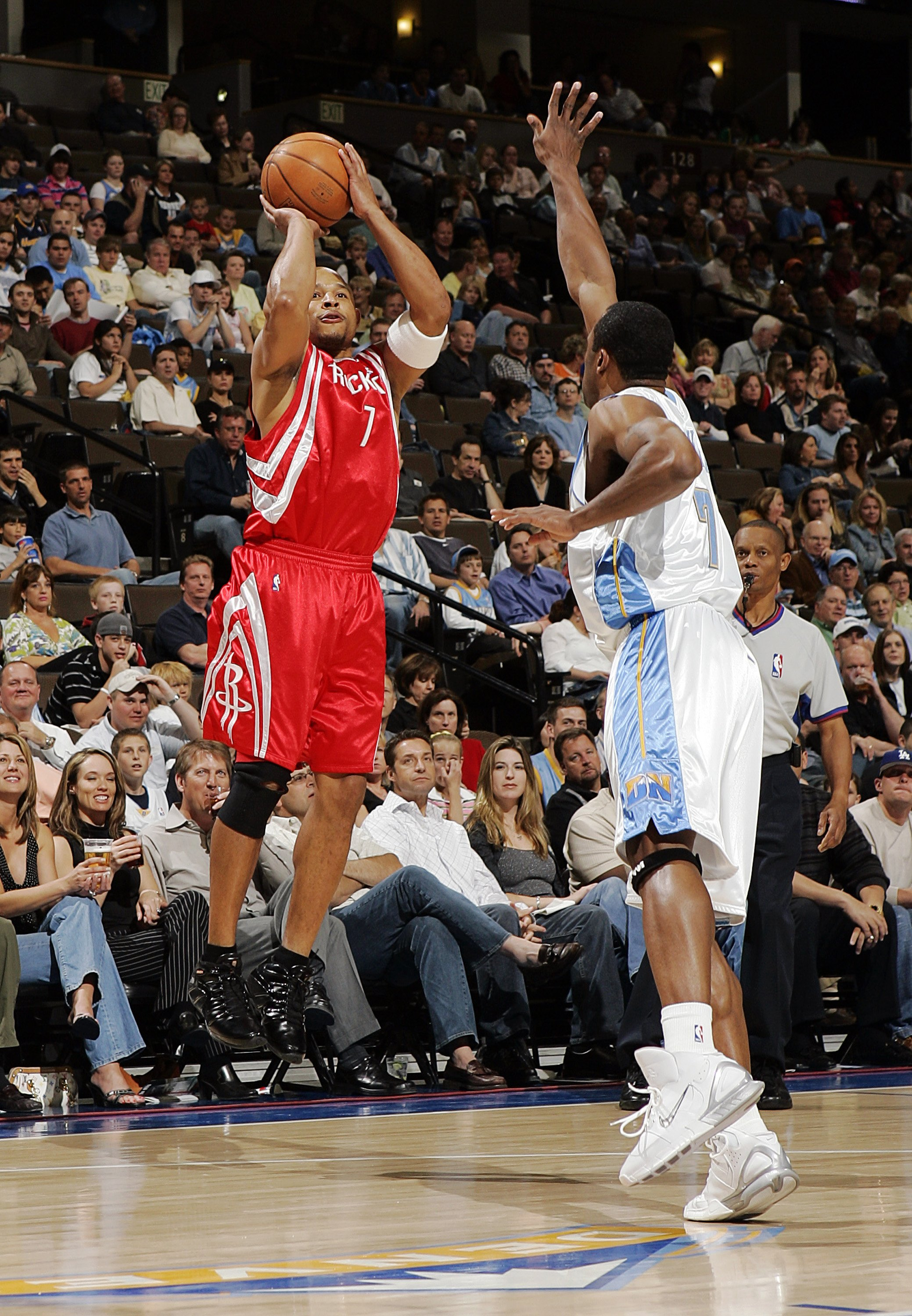 DENVER - APRIL 17:  David Wesley #7 of the Houston Rockets shoots over Greg Buckner #7 of the Denver Nuggets in the first quarter on April 17, 2006 at the Pepsi Center in Denver, Colorado.  NOTE TO USER: USER expressly acknowledges and agrees that, by dow