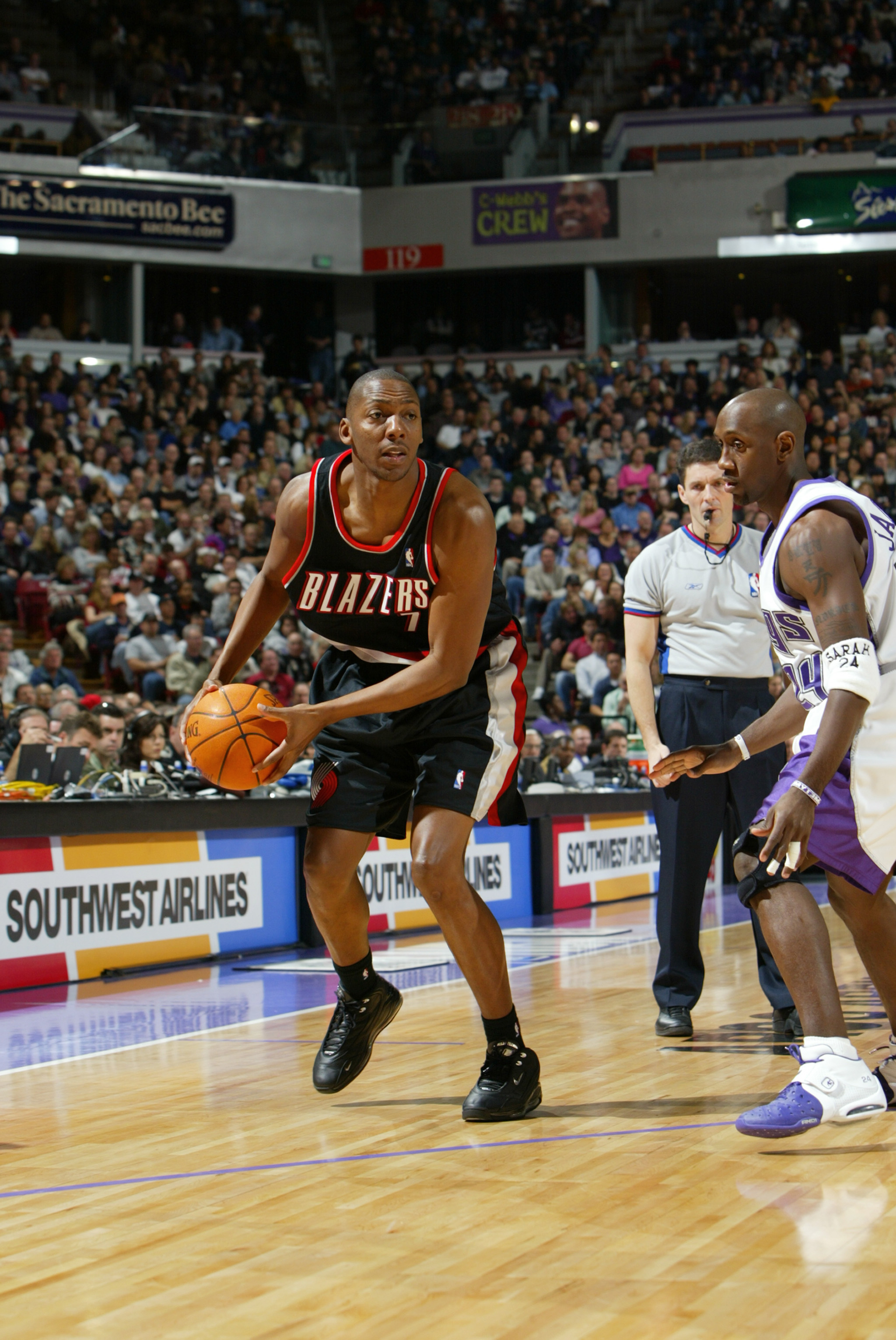 SACRAMENTO, CA - DECEMBER 21:  Wesley Person #7 of the Portland Trail Blazers is defended by Bobby Jackson #24 of the Sacramento Kings during the game at Arco Arena on December 21, 2003 in Sacramento, California.  The Kings won 117-98.   NOTE TO USER: Use