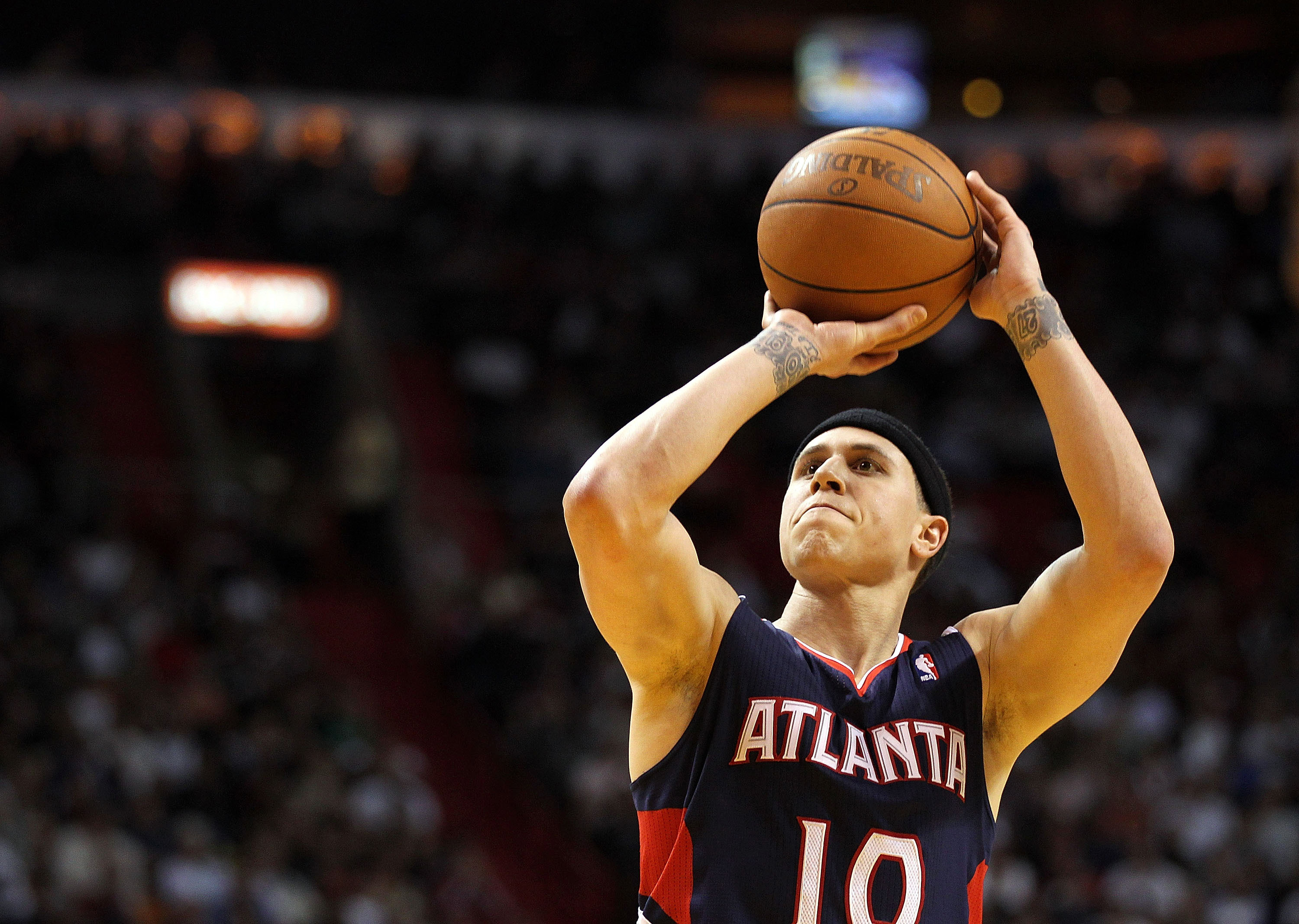 MIAMI, FL - JANUARY 18:  Mike Bibby #10 of the Atlanta Hawks shoots a free throw during a game against the Miami Heat at American Airlines Arena on January 18, 2011 in Miami, Florida. NOTE TO USER: User expressly acknowledges and agrees that, by downloadi
