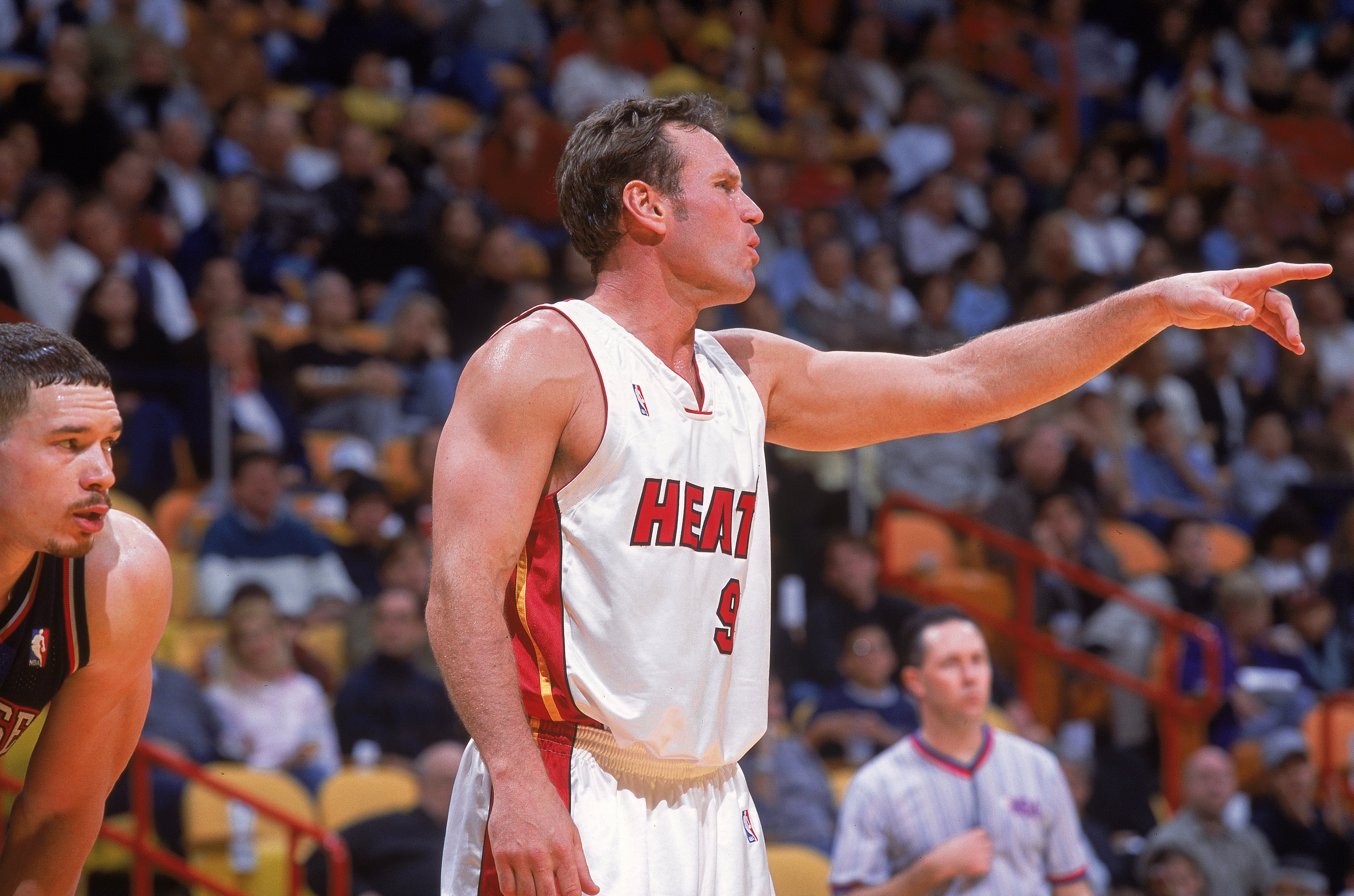 4 Jan 2001:  Dan Majerle #9 of the Miami Heat reacts to a play as Aaron Williams #34 of the New Jersey Nets looks on during the game at the American Airlines Arena in Miami, Florida.  The Heat defeated the Nets 81-78.  NOTE TO USER: It is expressly unders