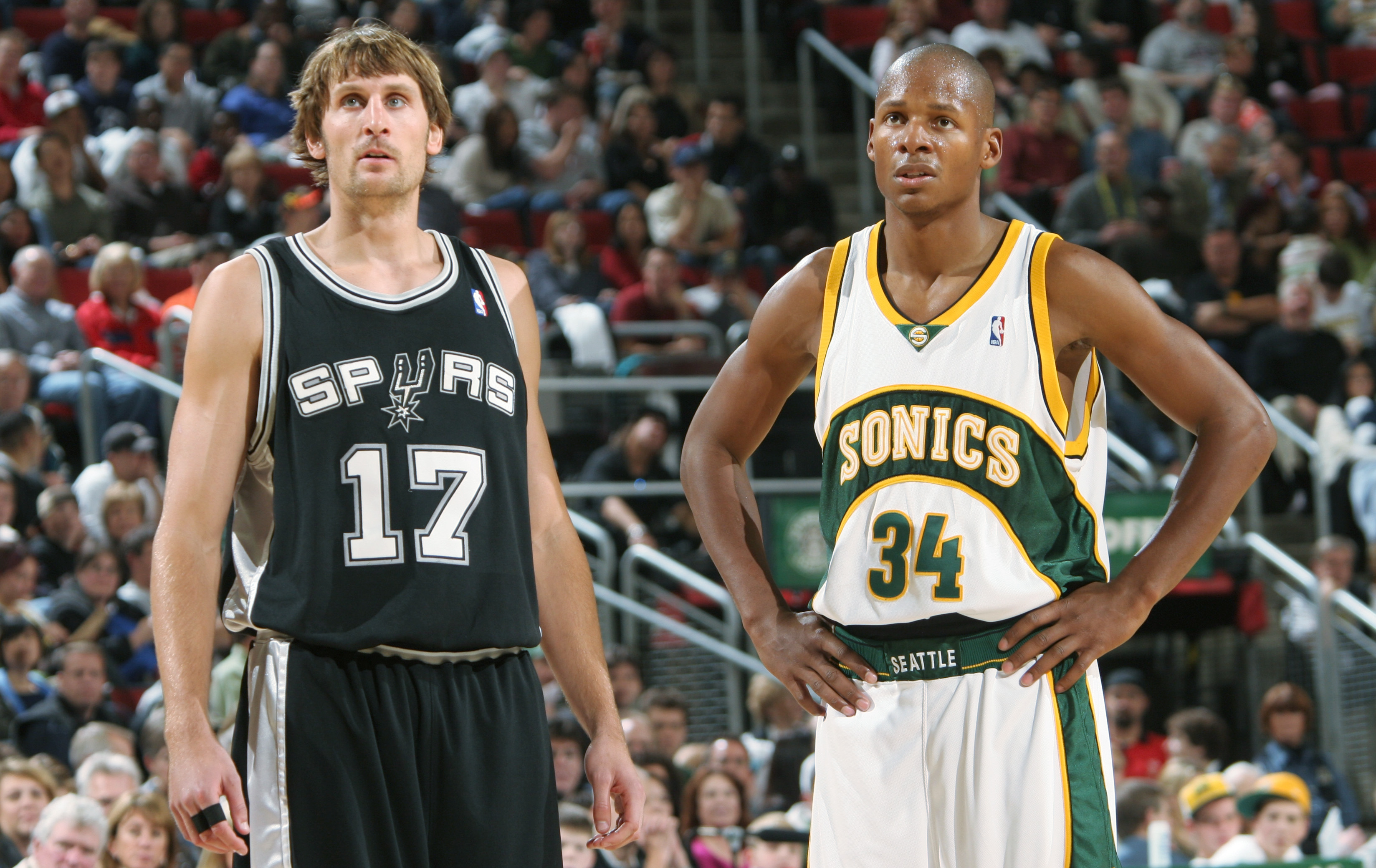 SEATTLE - NOVEMBER 7:  Brent Barry #17 of the San Antonio Spurs stands on the court next to Ray Allen #34 of the Seattle Sonics during the game at Key Arena on November 7, 2004 in Seattle, Washington. The Sonics won 113-94.  NOTE TO USER: User expressly a