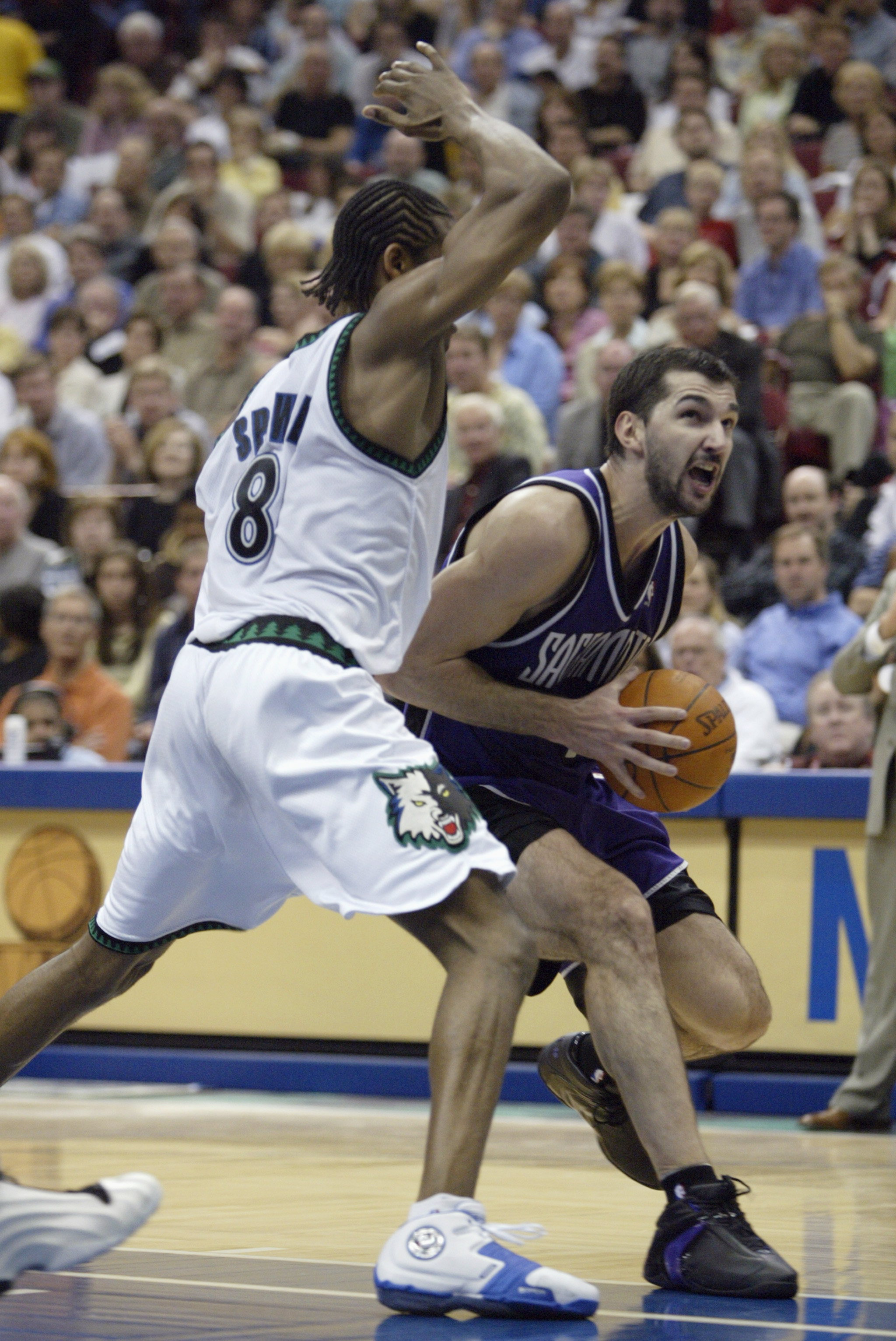 MINNEAPOLIS - MAY 8:  Latrell Sprewell #8 of the Minnesota Timberwolves defends Predrag Stojakovich #16 of the Sacramento Kings in Game Two of the Western Conference Semifinals during the 2004 NBA Playoffs on May 8, 2004 at the Target Center  in Minneapol