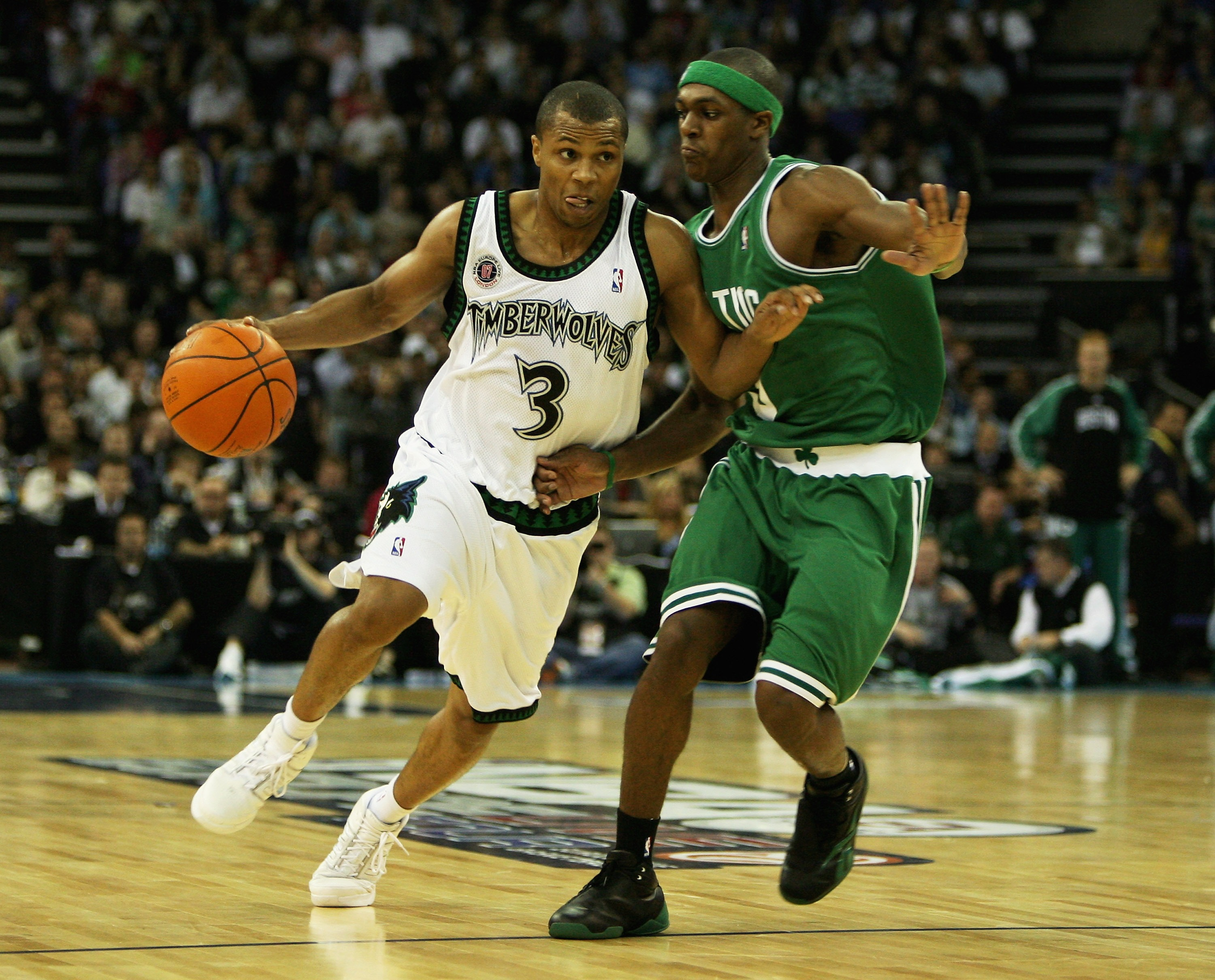 LONDON - OCTOBER 10:  Sebastian Telfair #3 of Minnesota is challenged by Rajon Rondo of Boston during NBA Europe Live 2007 Tour match between the Boston Celtics and the Minnesota Timberwolves at the O2 Arena on October 10, 2007 in London, England.  NOTE T