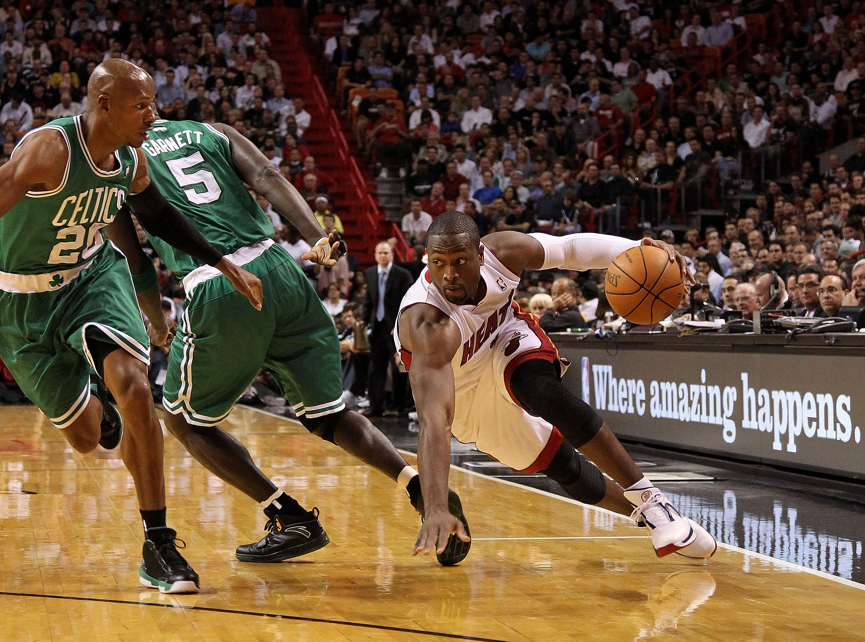 MIAMI - NOVEMBER 11:   Dwyane Wade #3 of the Miami Heat dribbles during a game against the Boston Celtics at American Airlines Arena on November 11, 2010 in Miami, Florida. NOTE TO USER: User expressly acknowledges and agrees that, by downloading and/or u