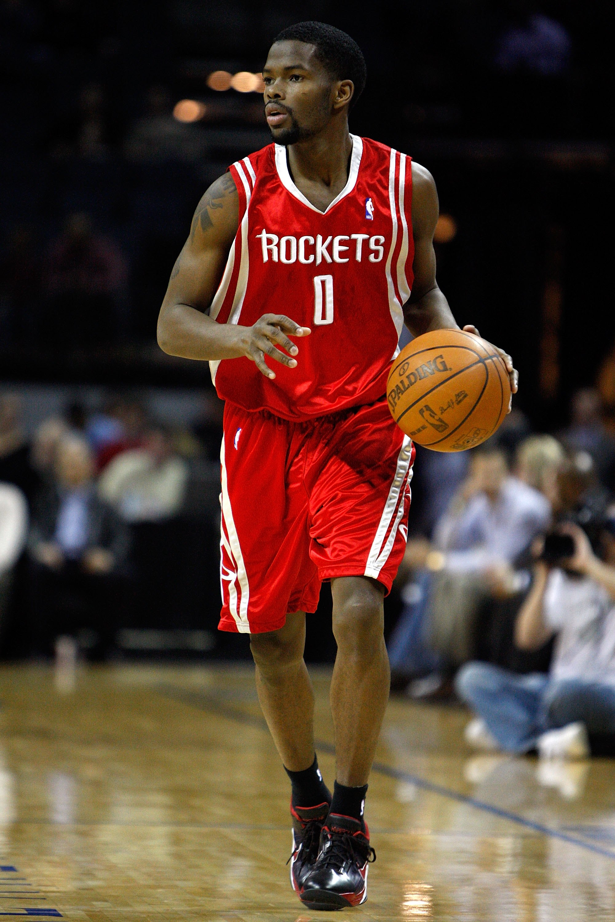 CHARLOTTE, NC - JANUARY 12:  Aaron Brooks #0 of the Houston Rockets brings the ball up court during the game against the Charlotte Bobcats on January 12, 2010 at Time Warner Cable Arena in Charlotte, North Carolina.  The Bobcats won 102-94.  NOTE TO USER: