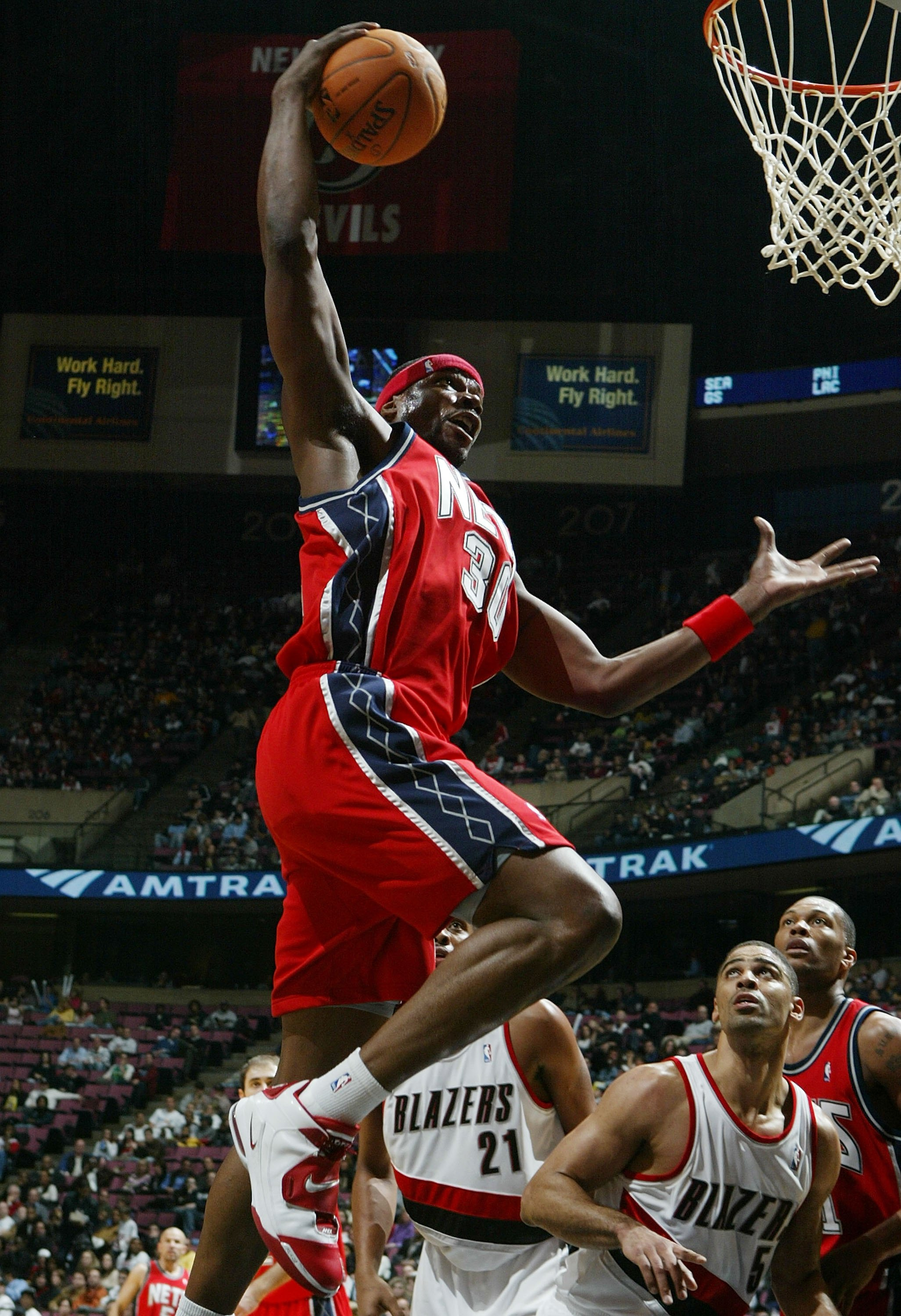EAST RUTHERFORD, NJ - NOVEMBER 18: Clifford Robinson #30 of the New Jersey Nets grabs a rebound against the Portland Trail Blazers during their game on November 18, 2006 at Continental Airlines Arena in East Rutherford, New Jersey. NOTE TO USER: User expr