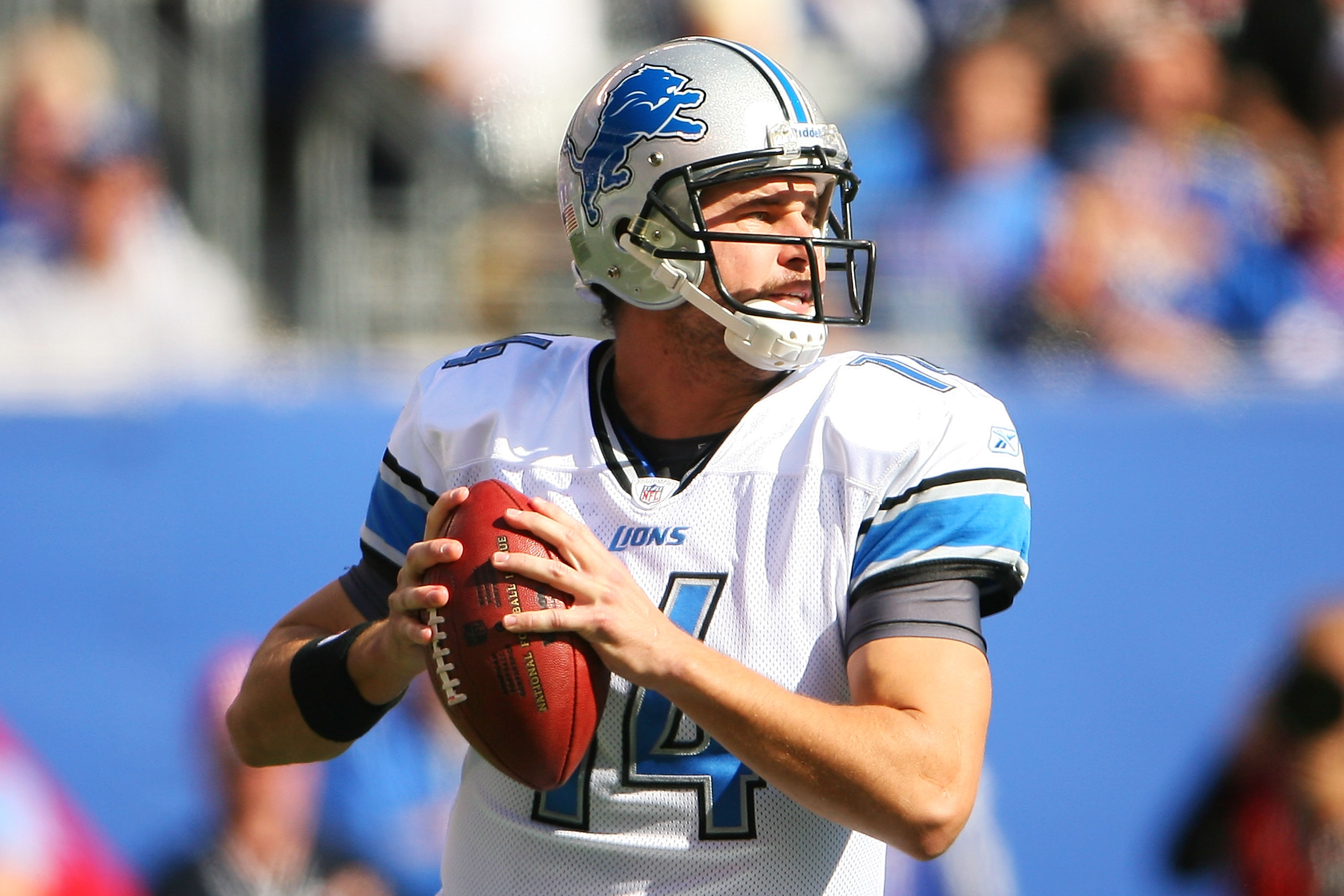 EAST RUTHERFORD, NJ - OCTOBER 17:  Shaun Hill #14 of the Detroit Lions drops back to pass against the New York Giants at New Meadowlands Stadium on October 17, 2010 in East Rutherford, New Jersey.  (Photo by Andrew Burton/Getty Images)