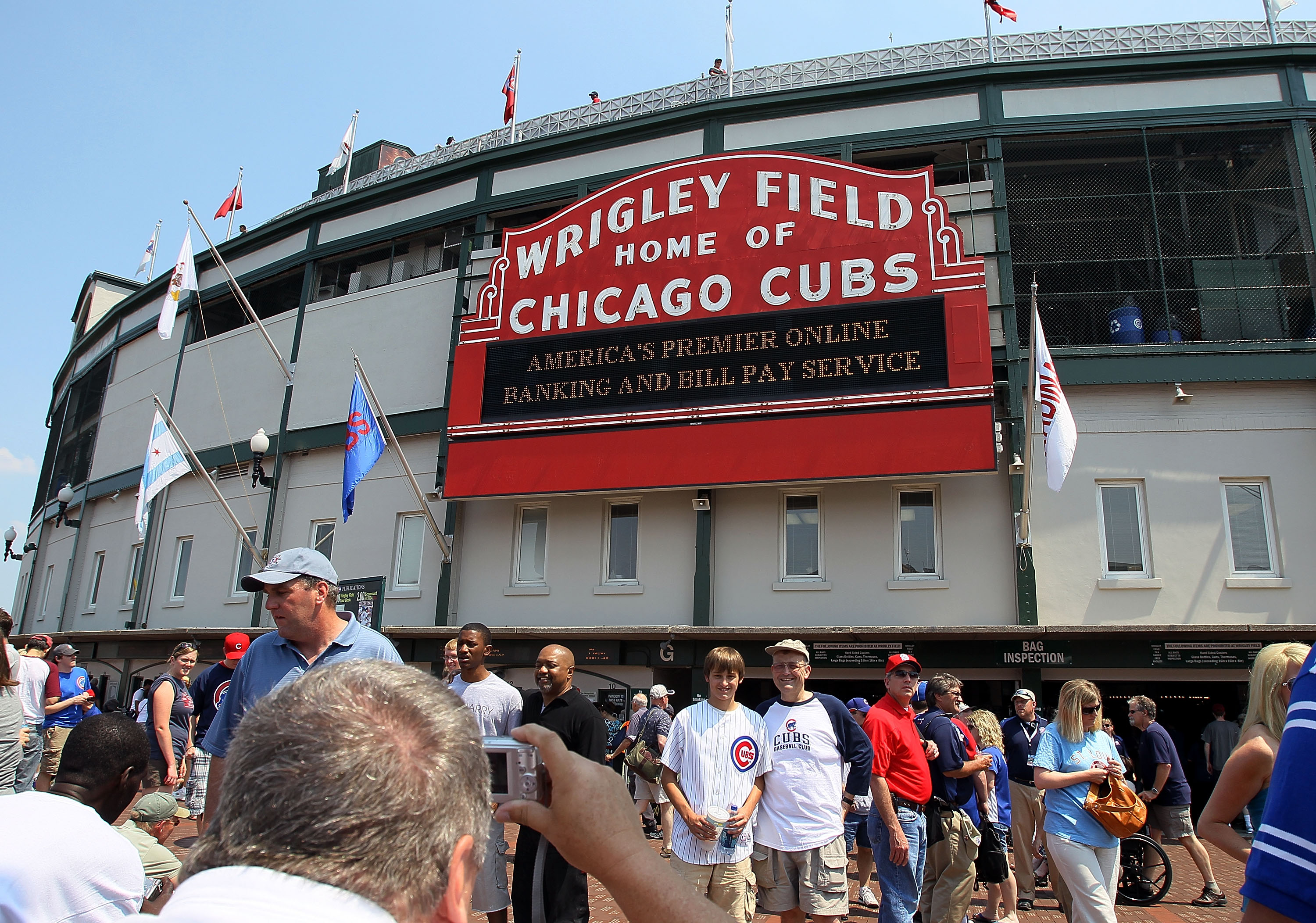 CHICAGO - MAY 30:  Fans arrive for the game between the St. Louis Cardinals and the Chicago Cubs on May 30, 2010 at Wrigley Field in Chicago, Illinois.  (Photo by Jim McIsaac/Getty Images)