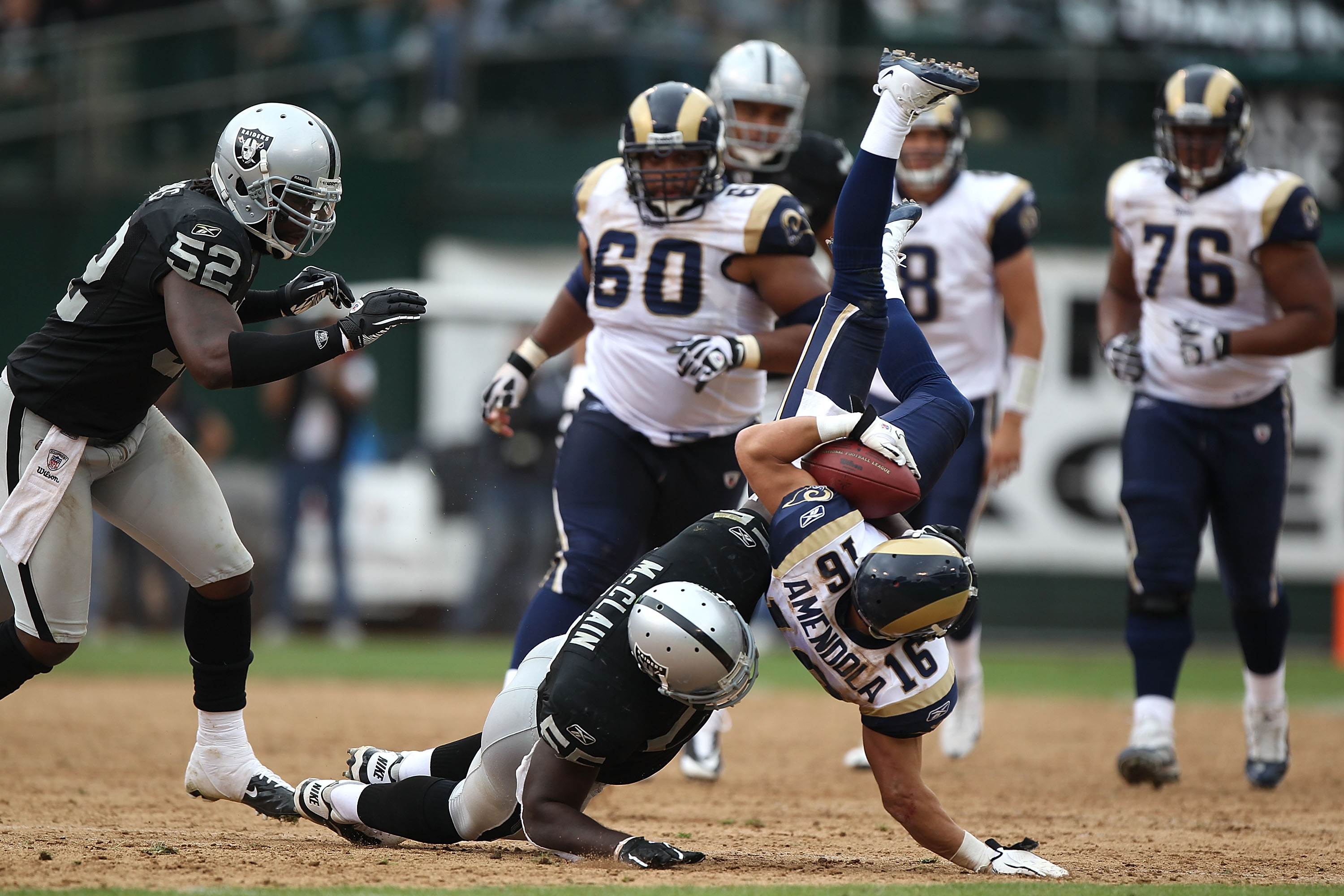 OAKLAND, CA - SEPTEMBER 19:  Danny Amendola #16 of the St. Louis Rams is tackled by Rolando McClain #51 of the Oakland Raiders during an NFL game at Oakland-Alameda County Coliseum on September 19, 2010 in Oakland, California.  (Photo by Jed Jacobsohn/Get