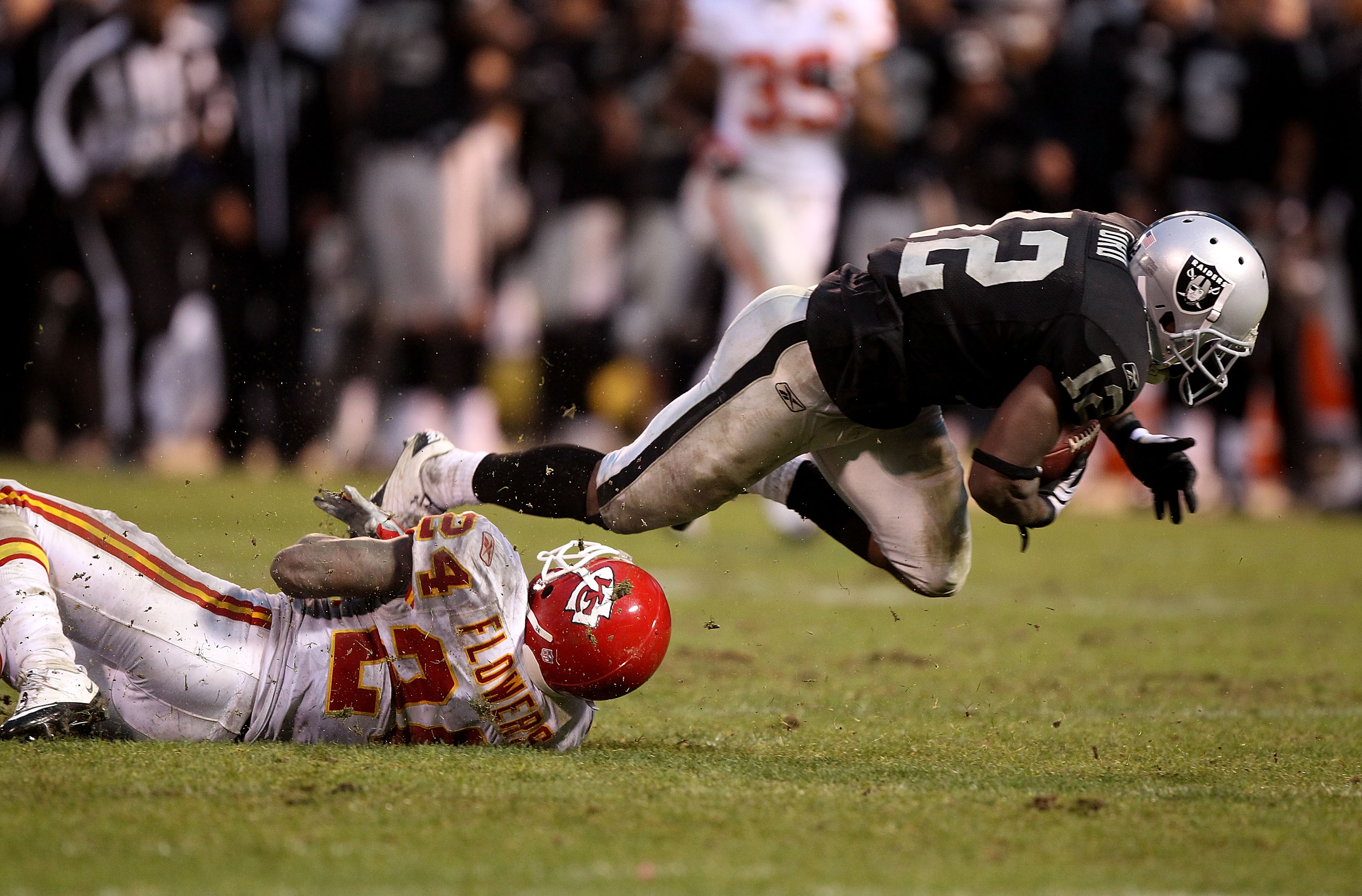 OAKLAND, CA - NOVEMBER 07:  Jacoby Ford #12 of the Oakland Raiders catches a pass over Brandon Flowers #24 of the Kansas City Chiefs in overtime during an NFL game at Oakland-Alameda County Coliseum on November 7, 2010 in Oakland, California.  (Photo by J