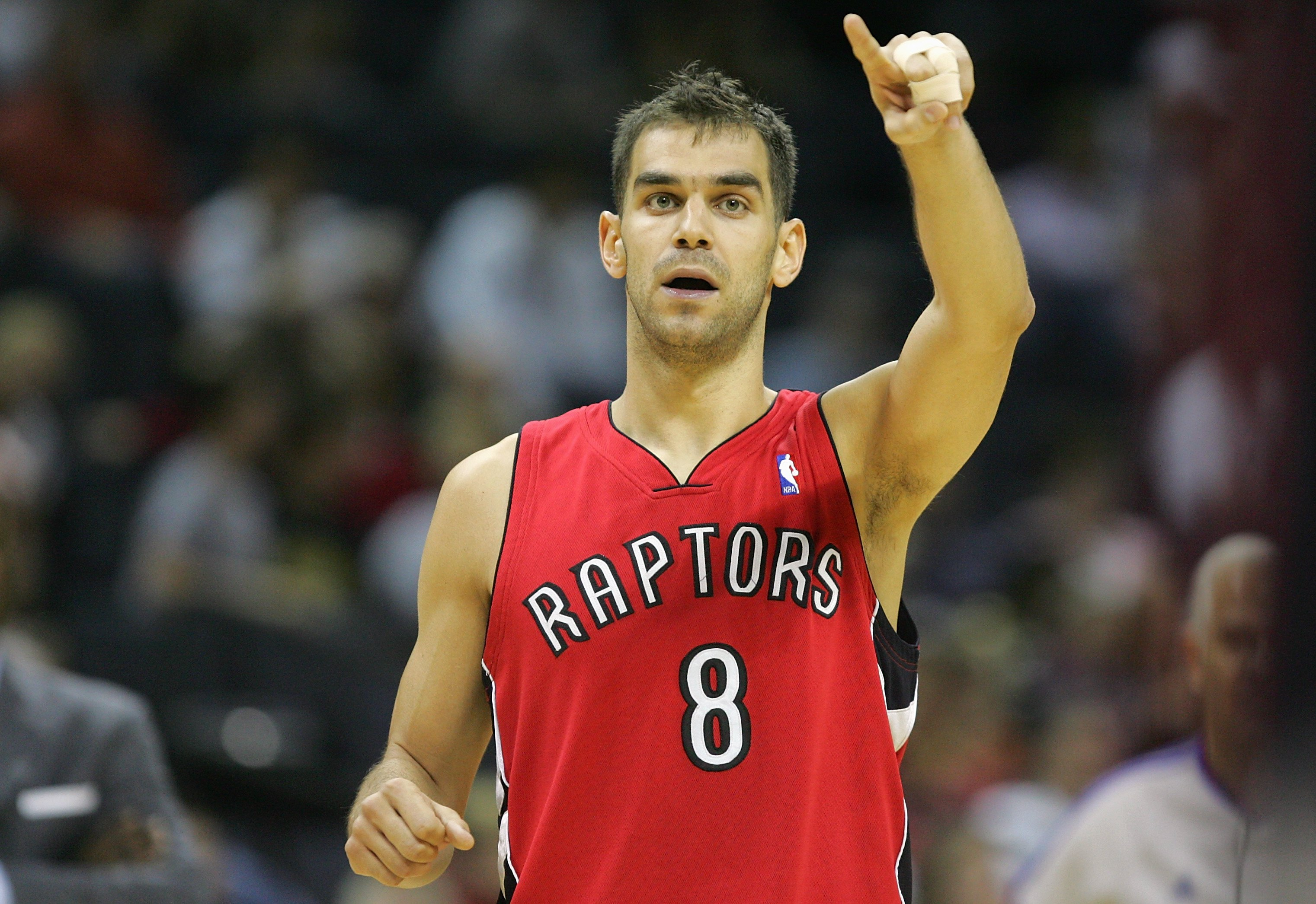 CHARLOTTE, NC - MARCH 2:  Jose Calderon #8 of the Toronto Raptors gestures during the game against the Charlotte Bobcats at Bobcats Arena on March 2, 2008 in Charlotte, North Carolina. The Bobcats won 110-98.  NOTE TO USER: User expressly acknowledges and