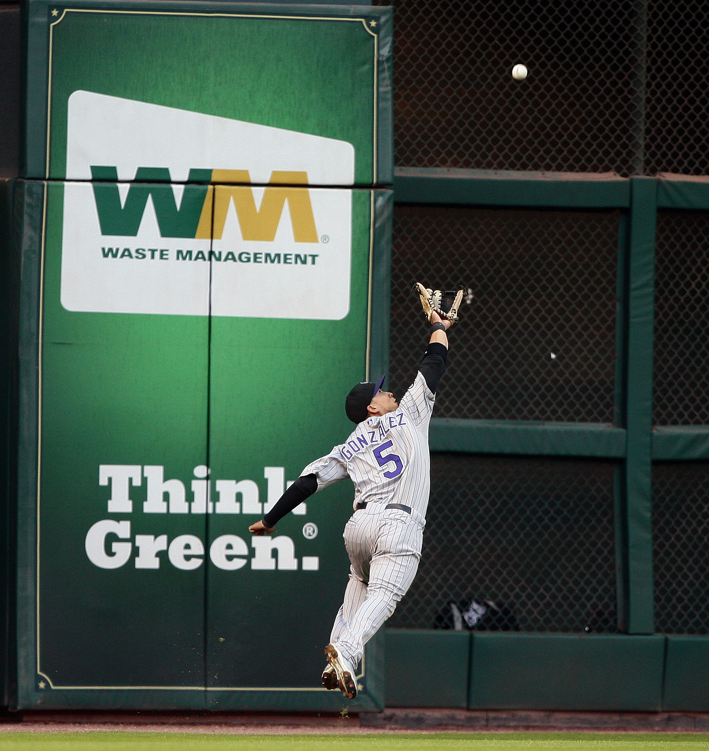 HOUSTON - MAY 19:  Left fielder Carlos Gonzalez #5 of the Colorado Rockies can't reach a hard hit ball by Tommy Manzella of the Houston Astros at Minute Maid Park on May 19, 2010 in Houston, Texas.  (Photo by Bob Levey/Getty Images)