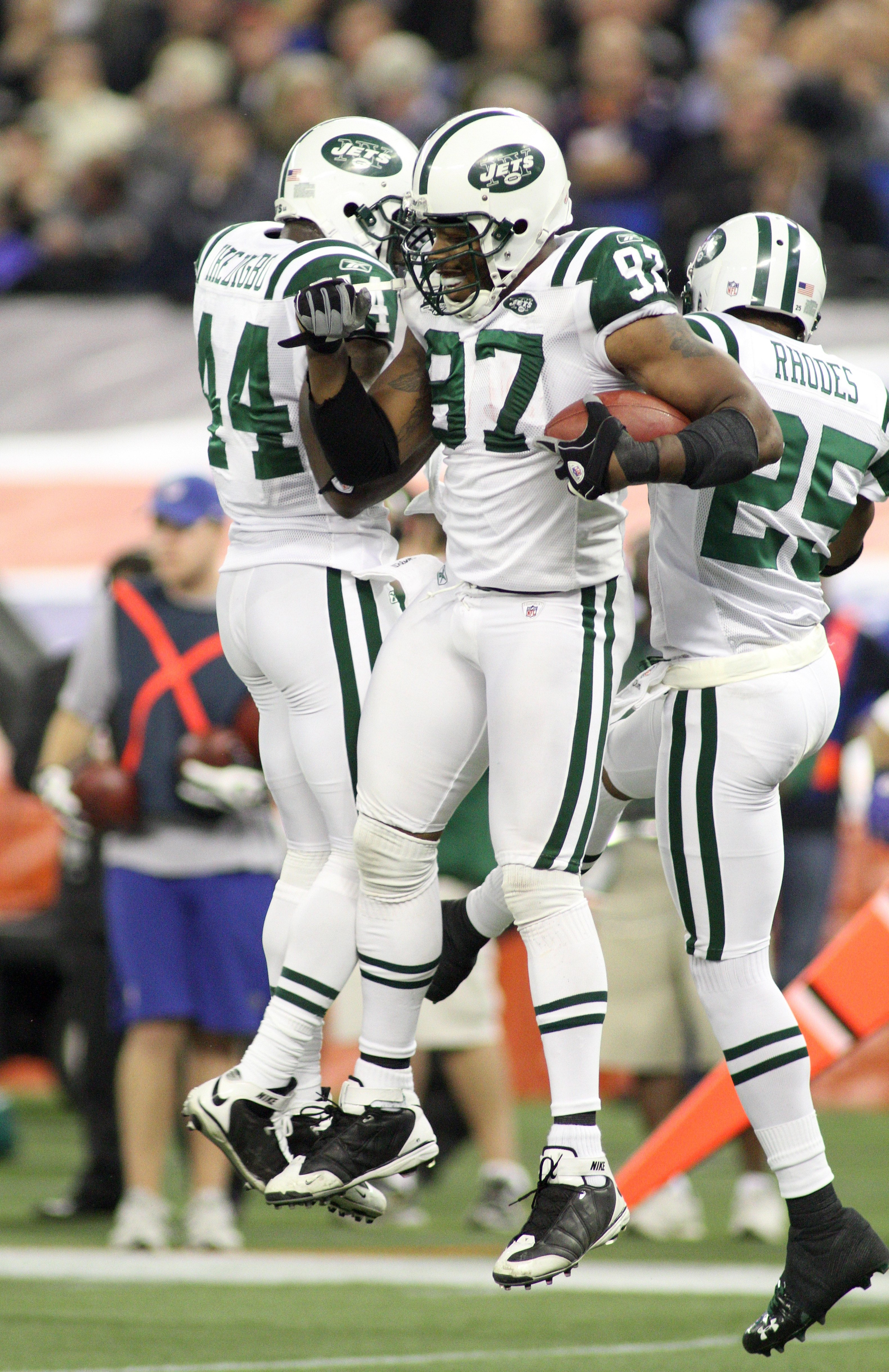 TORONTO - DECEMBER 3:  (L-R) James Ihedigbo #44, Calvin Pace #97 and Kerry Rhodes #25 of the New York Jets celebrate after a defensive play during their NFL game against the Buffalo Bills on December 3, 2009  at Rogers Centre in Toronto, Ontario, Canada.
