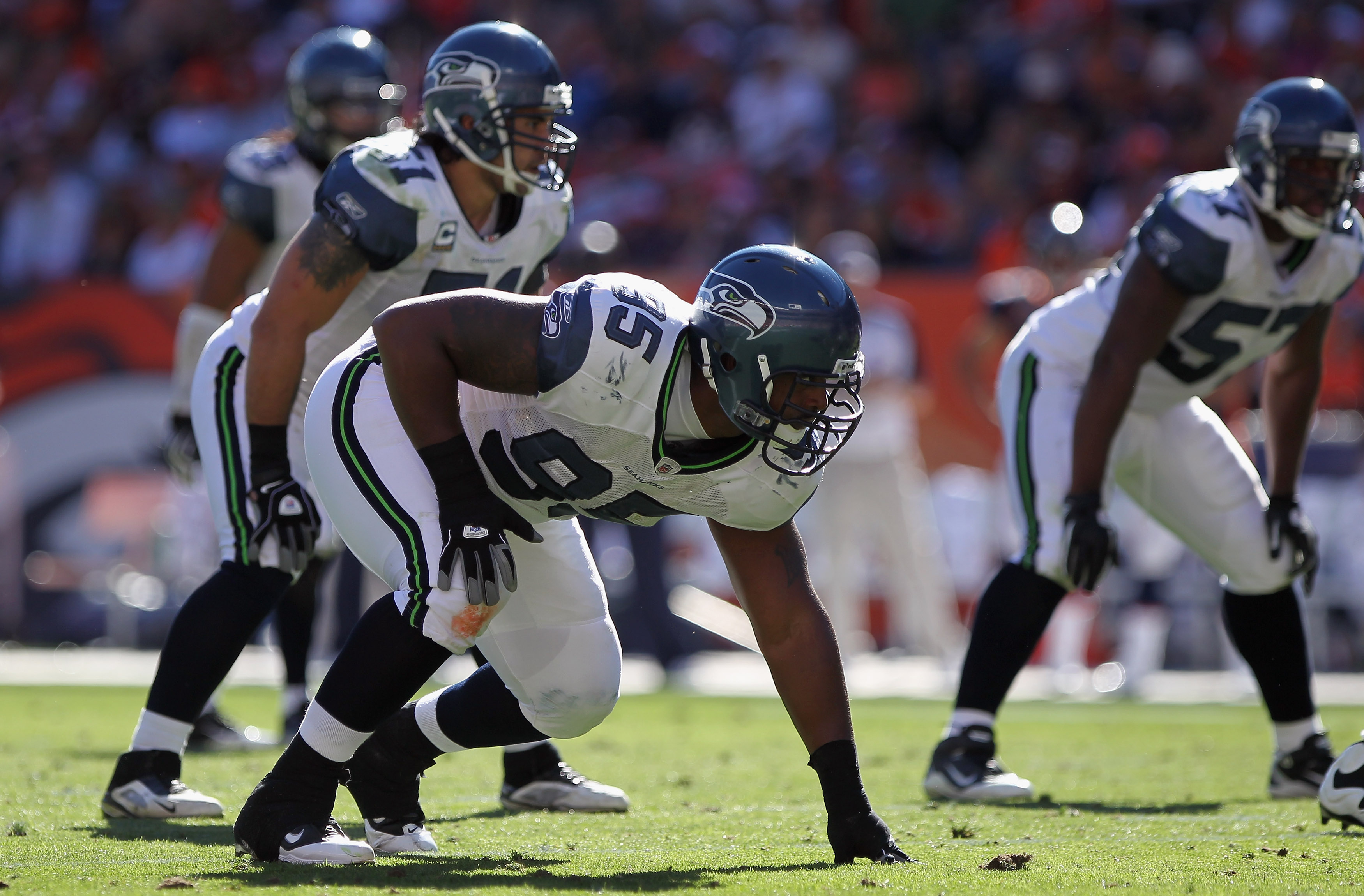 DENVER - SEPTEMBER 19:  Defensive tackle Kentwan Balmer #95 of the Seattle Seahawks awaits the snap against the Denver Broncos at INVESCO Field at Mile High on September 19, 2010 in Denver, Colorado The Broncos defeated the Seahawks 31-14..  (Photo by Dou