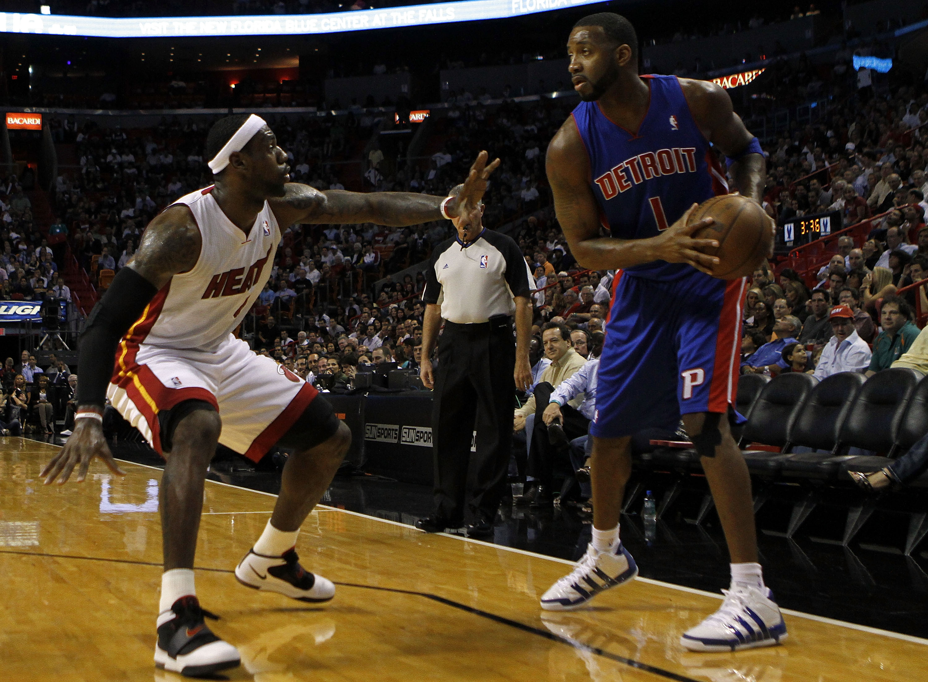 MIAMI - OCTOBER 05:  Forward LeBron James #6 of the Miami Heat takes on giard Tracy McGrady #1of the Detroit Pistons on October 5, 2010 in Miami, Florida.  NOTE TO USER: User expressly acknowledges and agrees that, by downloading and or using this photogr