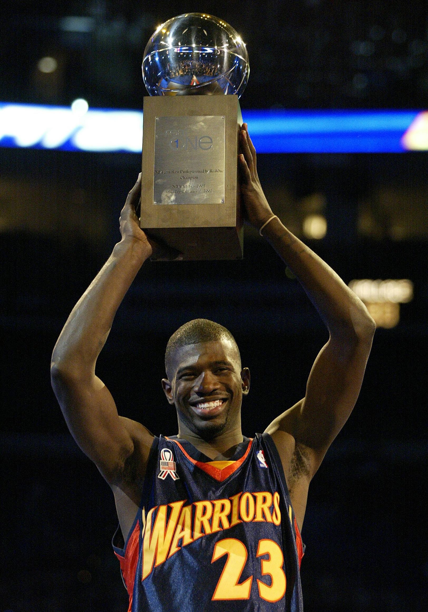 9 Feb 2002:  Jason Richardson of the Golden State Warriors holds the winner's trophy after winning the NBA.Com Slam Dunk competition during the NBA All-Star Weekend at the First Union Center in Philadelphia, Pennsylvania. Richardson won the event and the