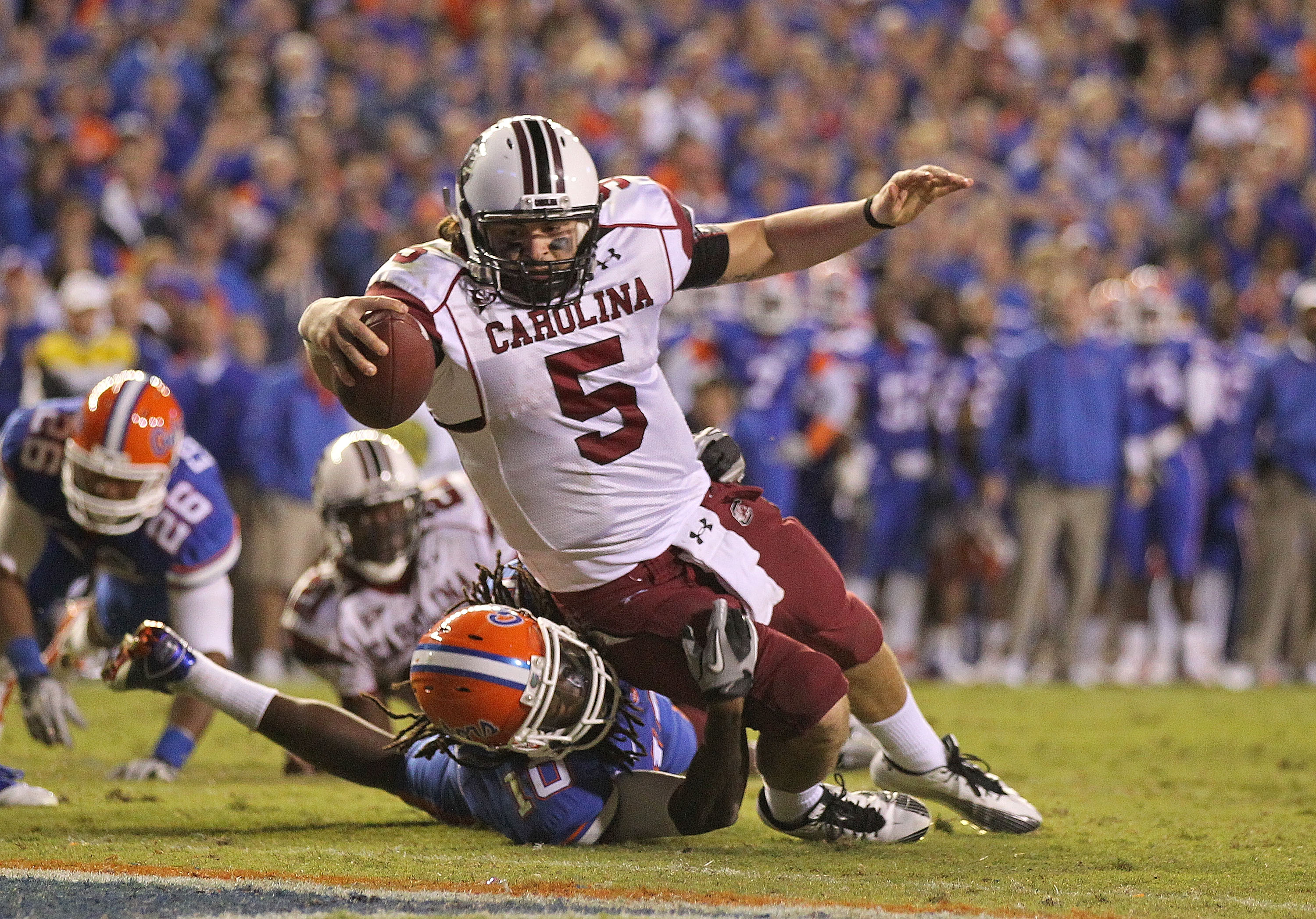 GAINESVILLE, FL - NOVEMBER 13:  Stephen Garcia #5 of the South Carolina Gamecocks rushes for a touchdown against Will Hill #10 of the Florida Gators during a game at Ben Hill Griffin Stadium on November 13, 2010 in Gainesville, Florida. The Gamecocks beat