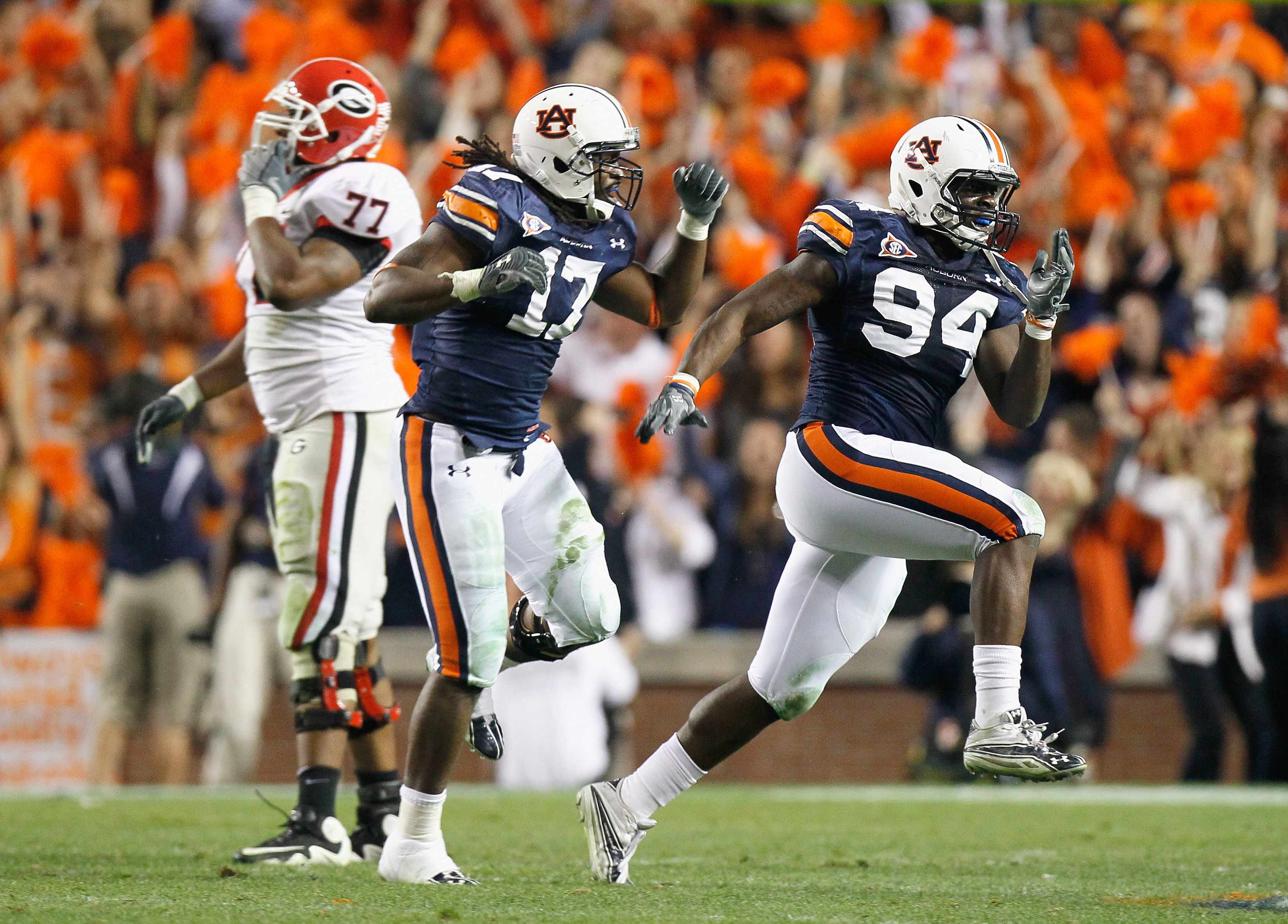 AUBURN, AL - NOVEMBER 13:  Nosa Eguae #94 and Josh Bynes #17 of the Auburn Tigers react after a defensive stop of fourth down for the Georgia Bulldogs at Jordan-Hare Stadium on November 13, 2010 in Auburn, Alabama.  (Photo by Kevin C. Cox/Getty Images)
