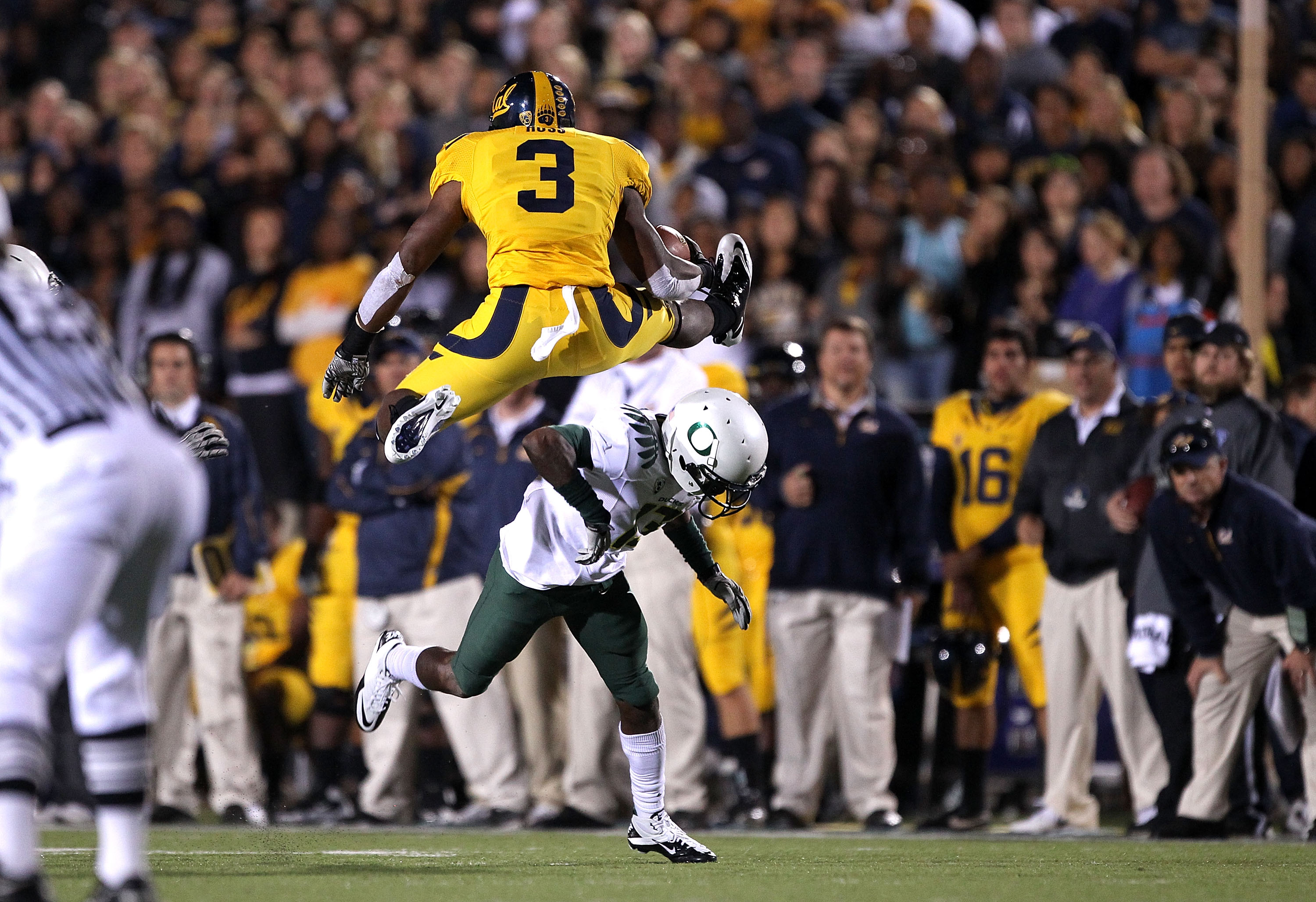BERKELEY, CA - NOVEMBER 13:  Jeremy Ross #3 of the California Golden Bears jumps over Cliff Harris #13 of the Oregon Ducks at California Memorial Stadium on November 13, 2010 in Berkeley, California.  (Photo by Ezra Shaw/Getty Images)