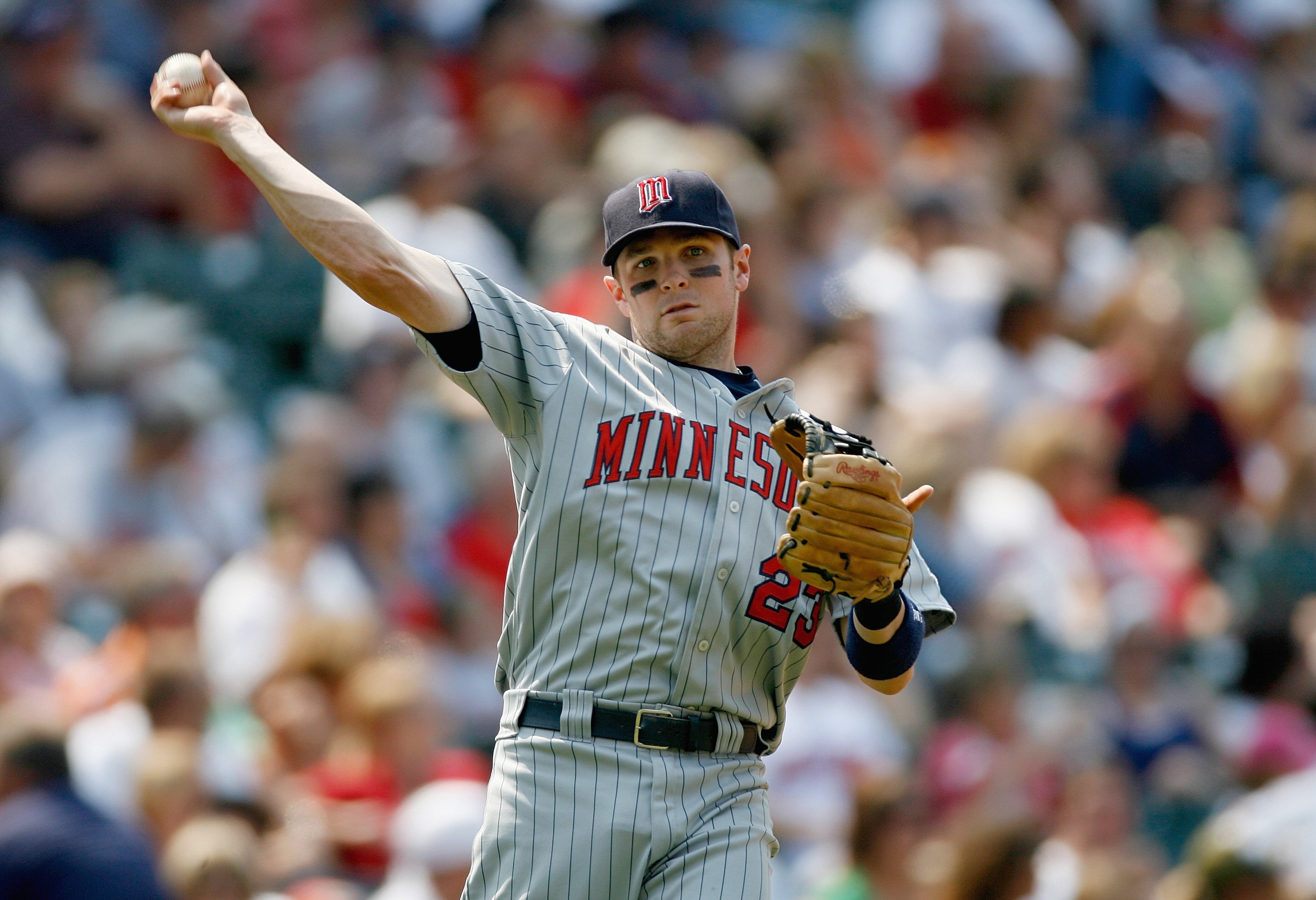 CLEVELAND - JULY 27:  Brendan Harris #23 of the Minnesota Twins fields during the game against the Cleveland Indians at Progressive Field on July 27, 2008 in Cleveland, Ohio.  (Photo by:  Gregory Shamus/Getty Images)