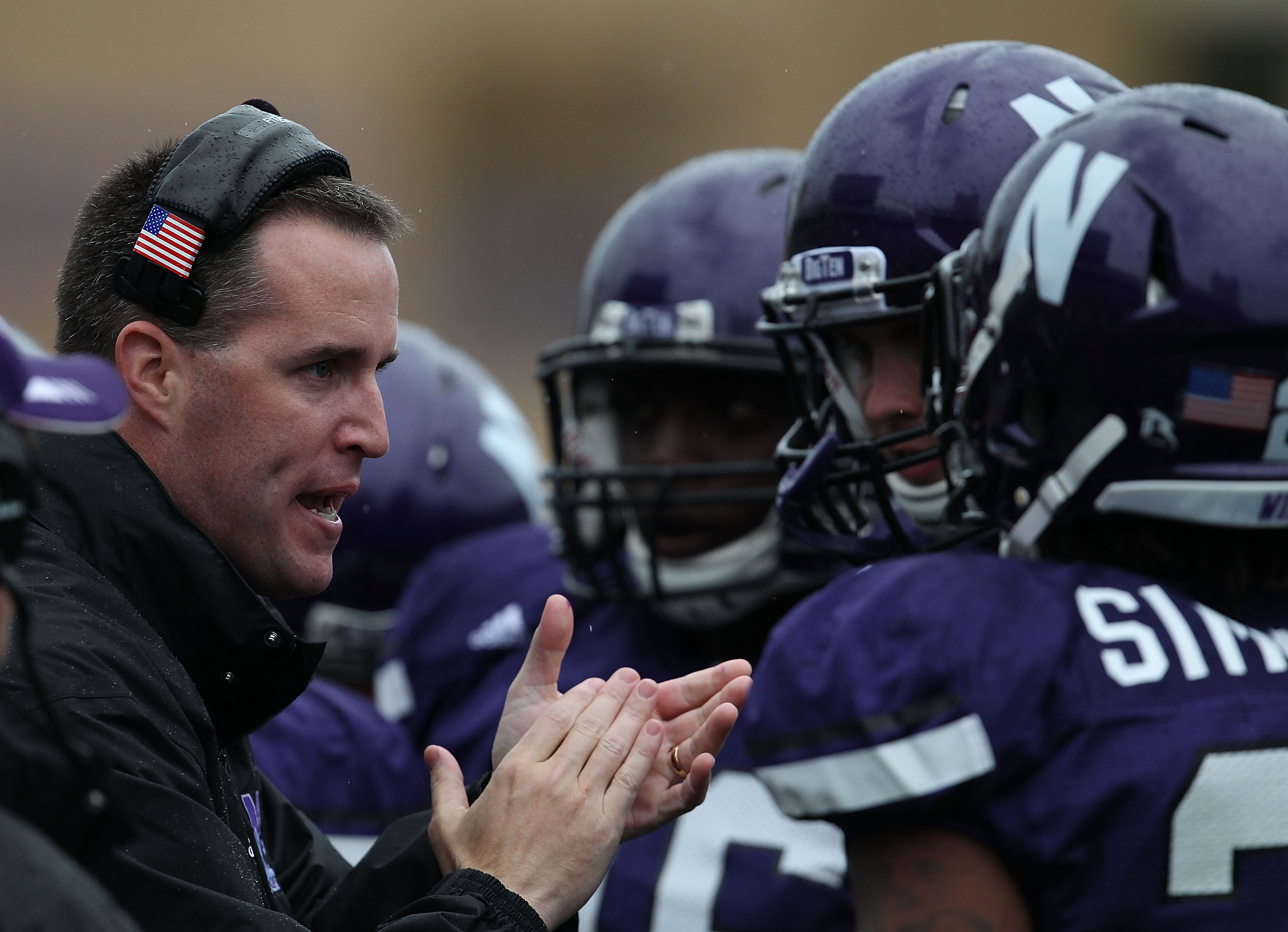 EVANSTON, IL - OCTOBER 23: Head coach Pat Fitzgerald of the Northwestern Wildcats encourages his team as they take on the Michigan State Spartans at Ryan Field on October 23, 2010 in Evanston, Illinois. Michigan State defeated Northwestern 35-27. (Photo b