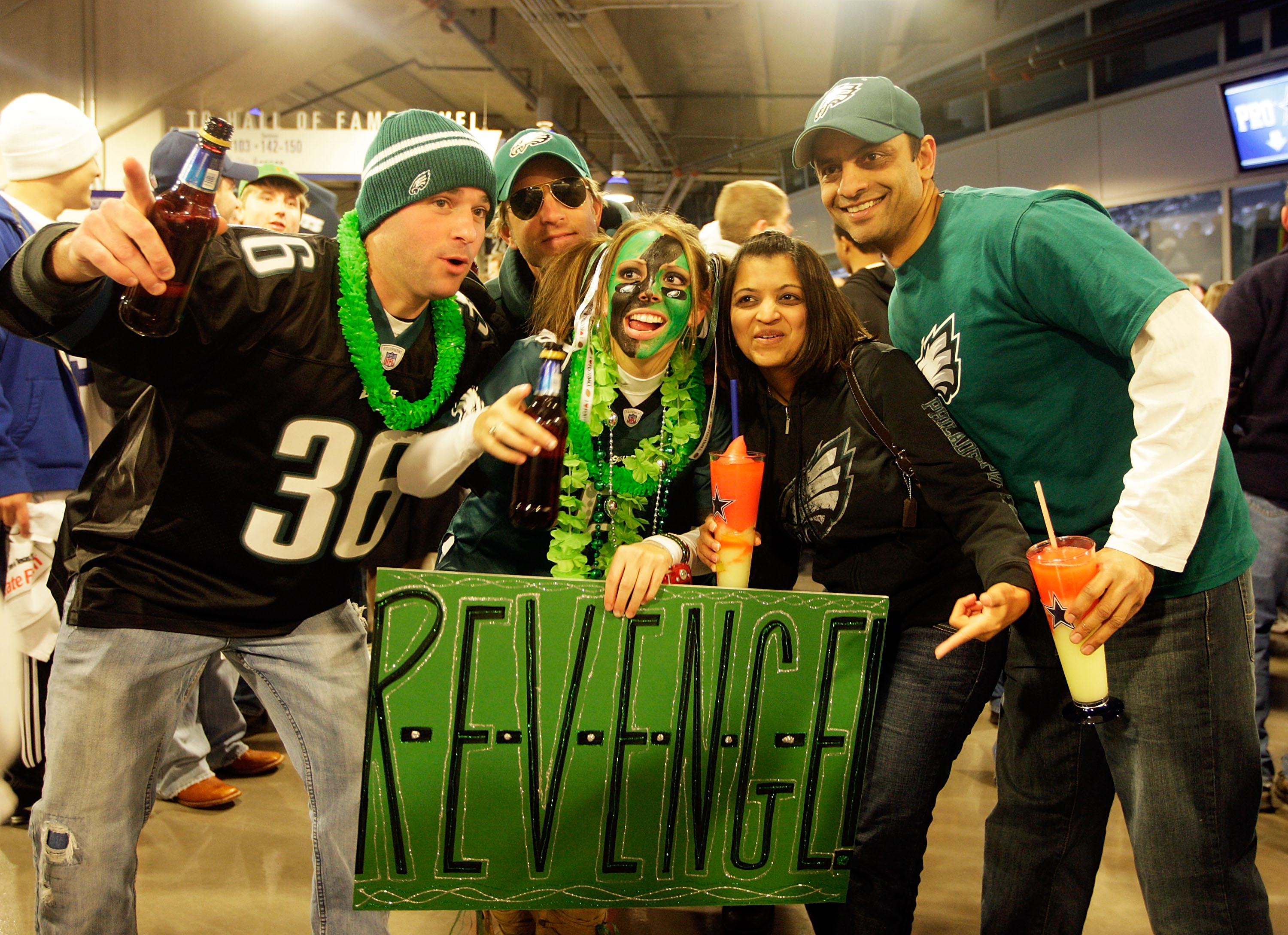 ARLINGTON, TX - JANUARY 09:  Philadelphia Eagles fans pose on the concourse prior to the start of the 2010 NFC wild-card playoff game against the Dallas Cowboys on January 9, 2010 at Cowboys Stadium in Arlington, Texas.  (Photo by Jamie Squire/Getty Image