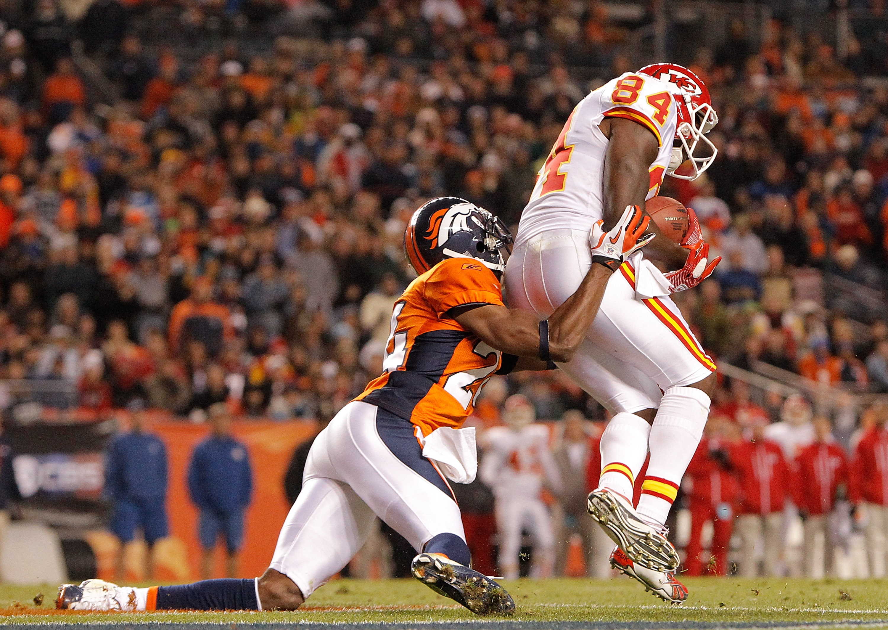 DENVER - NOVEMBER 14:  Wide receiver Chris Chambers #84 of the Kansas City Chiefs makes a reception for a touchdown in front of cornerback Champ Bailey #24 of the Denver Broncos during the fourth quarter at INVESCO Field at Mile High on November 14, 2010