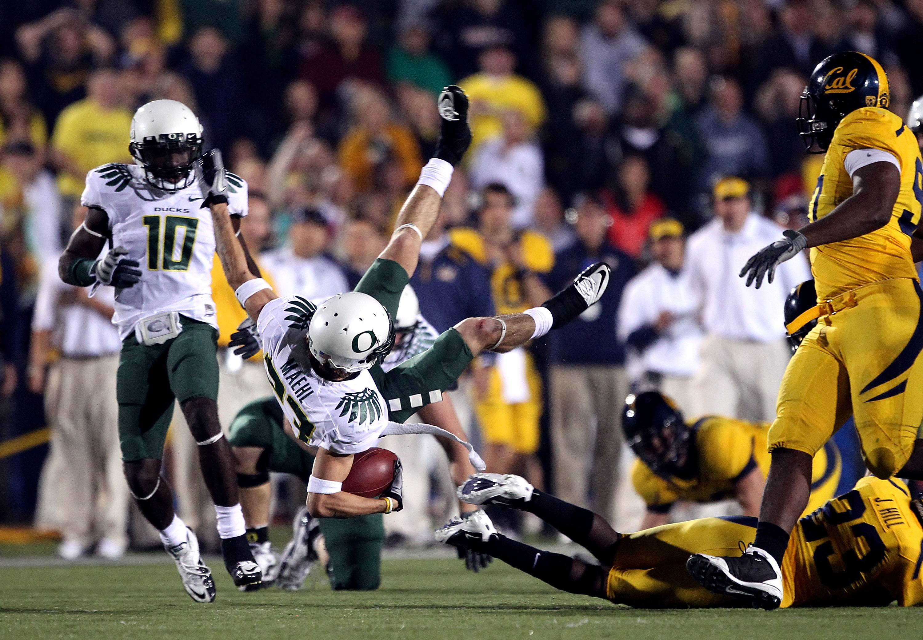 BERKELEY, CA - NOVEMBER 13:  Jeff Maehl #23 of the Oregon Ducks flies through the air after being hit by the California Golden Bears  at California Memorial Stadium on November 13, 2010 in Berkeley, California.  (Photo by Ezra Shaw/Getty Images)