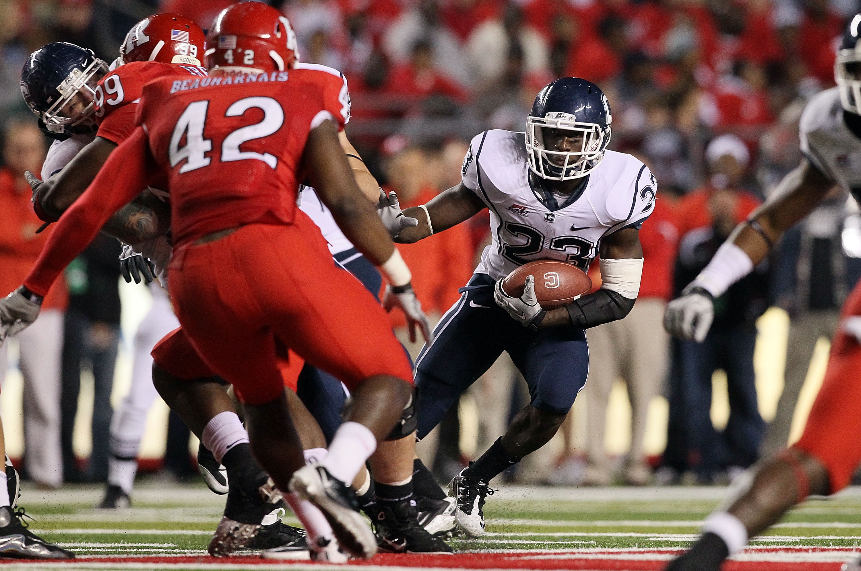 PISCATAWAY, NJ - OCTOBER 08:  Jordan Todman #23 of the Connecticut Huskies runs the ball against the Rutgers Scarlet Knights at Rutgers Stadium on October 8, 2010 in Piscataway, New Jersey. Rutgers defeated UConn 27-24.  (Photo by Jim McIsaac/Getty Images