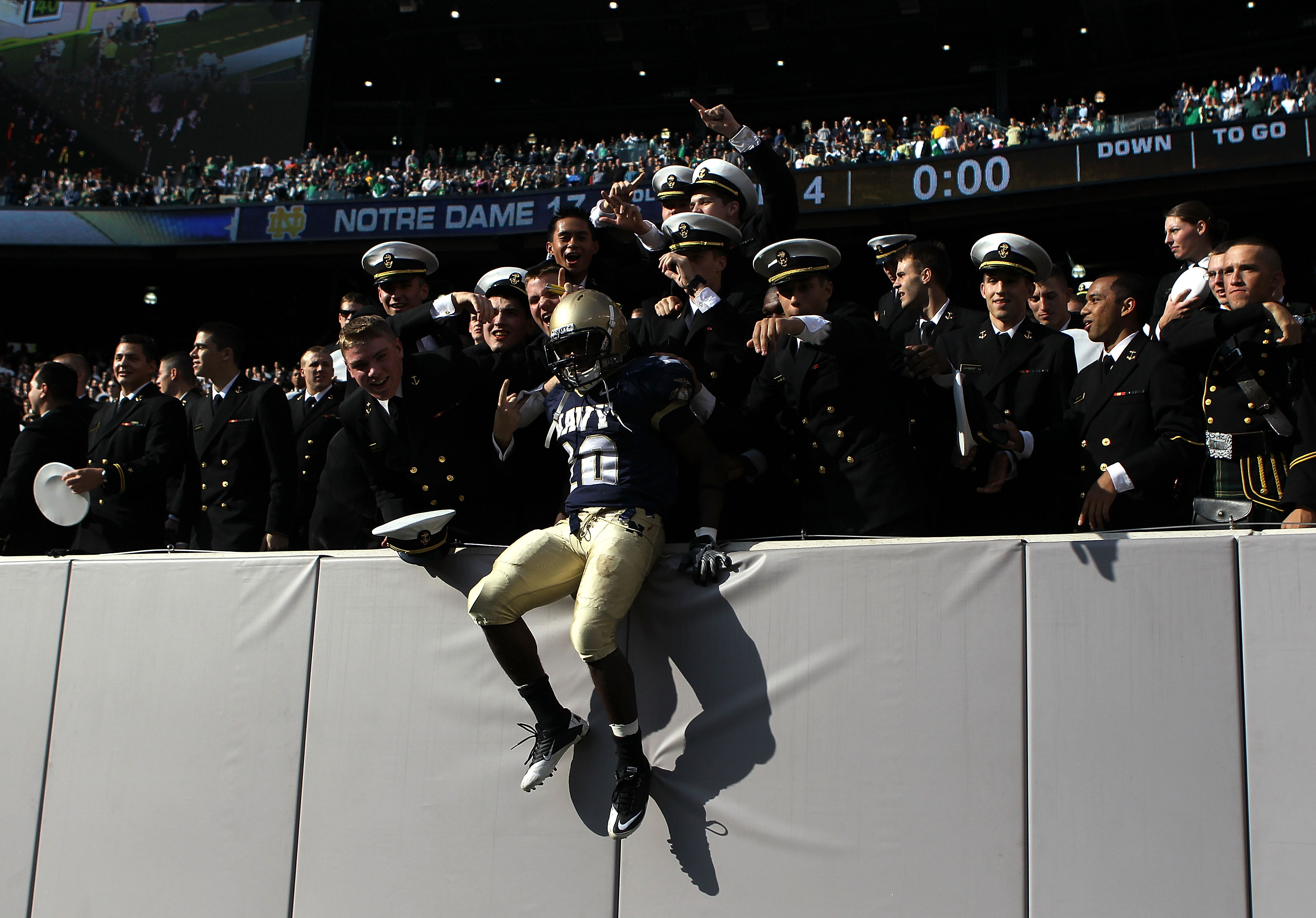 EAST RUTHERFORD, NJ - OCTOBER 23: Andre Byrd #20 of the Navy Midshipmen celebrates the win against the Notre Dame Fighting Irish at New Meadowlands Stadium on October 23, 2010 in East Rutherford, New Jersey.  (Photo by Nick Laham/Getty Images)