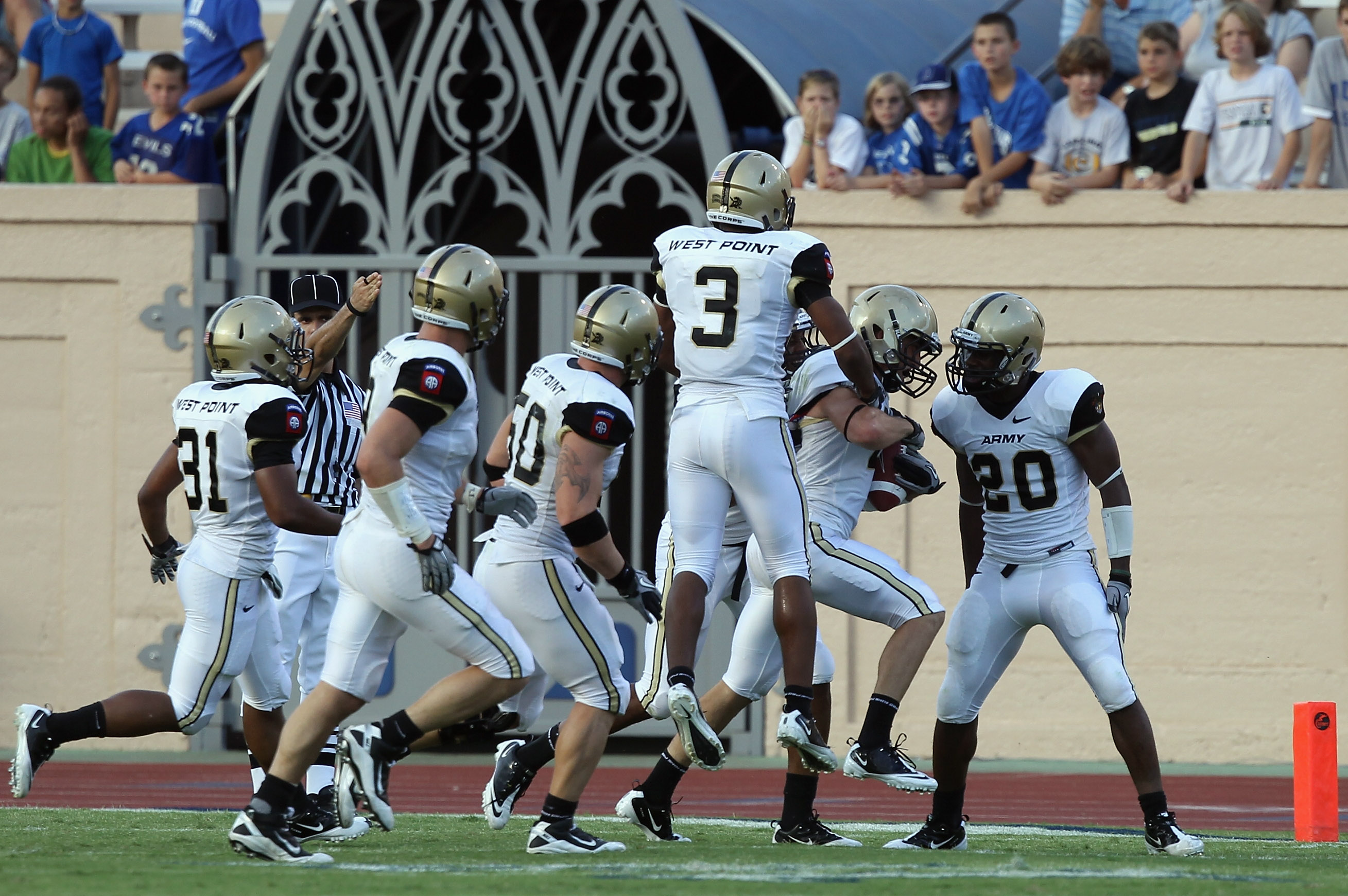 DURHAM, NC - SEPTEMBER 25:  Richard King #2 of the Army Black Knights celebrates with teammates after an interception that sealed the game in a 35-21 victory over the Duke Blue Devils at Wallace Wade Stadium on September 25, 2010 in Durham, North Carolina