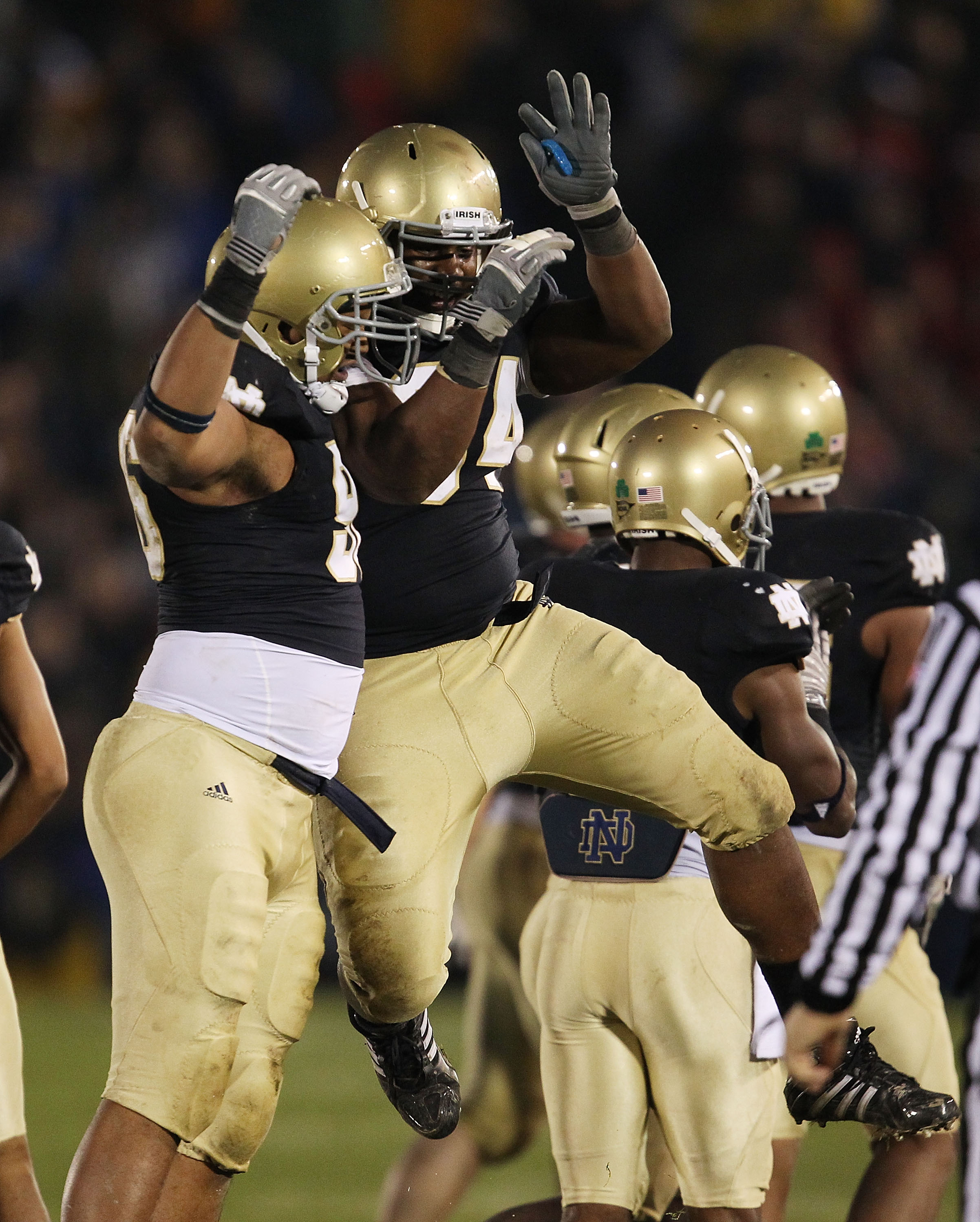 SOUTH BEND, IN - NOVEMBER 13: (L-R) Kona Schwenke #96 and Hafis Williams #94 of the Notre Dame Fighting Irish celebrate a win over the Utah Utes at Notre Dame Stadium on November 13, 2010 in South Bend, Indiana. Notre Dame defeated Utah 28-3. (Photo by Jo