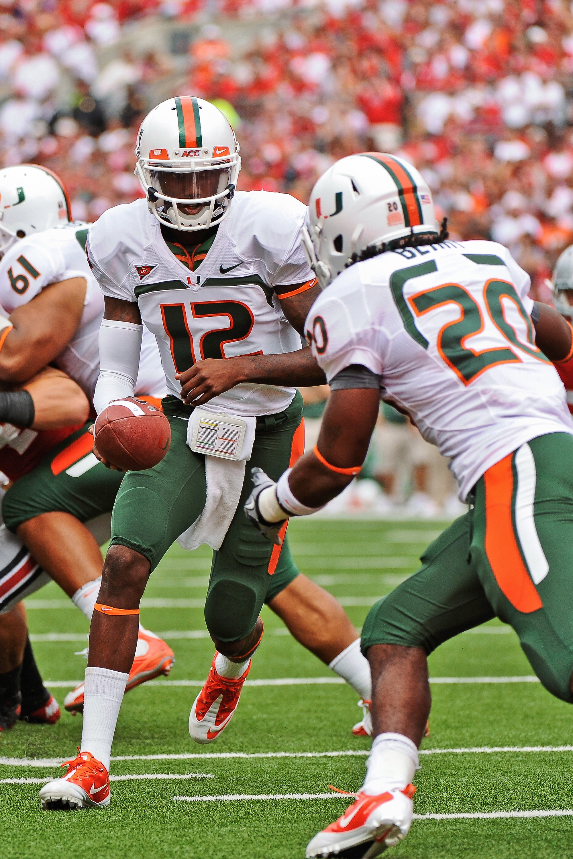 COLUMBUS, OH - SEPTEMBER 11:  Quarterback Jacory Harris #12 of the Miami Hurricanes hands the ball off to a running back against the Ohio State Buckeyes at Ohio Stadium on September 11, 2010 in Columbus, Ohio.  (Photo by Jamie Sabau/Getty Images)