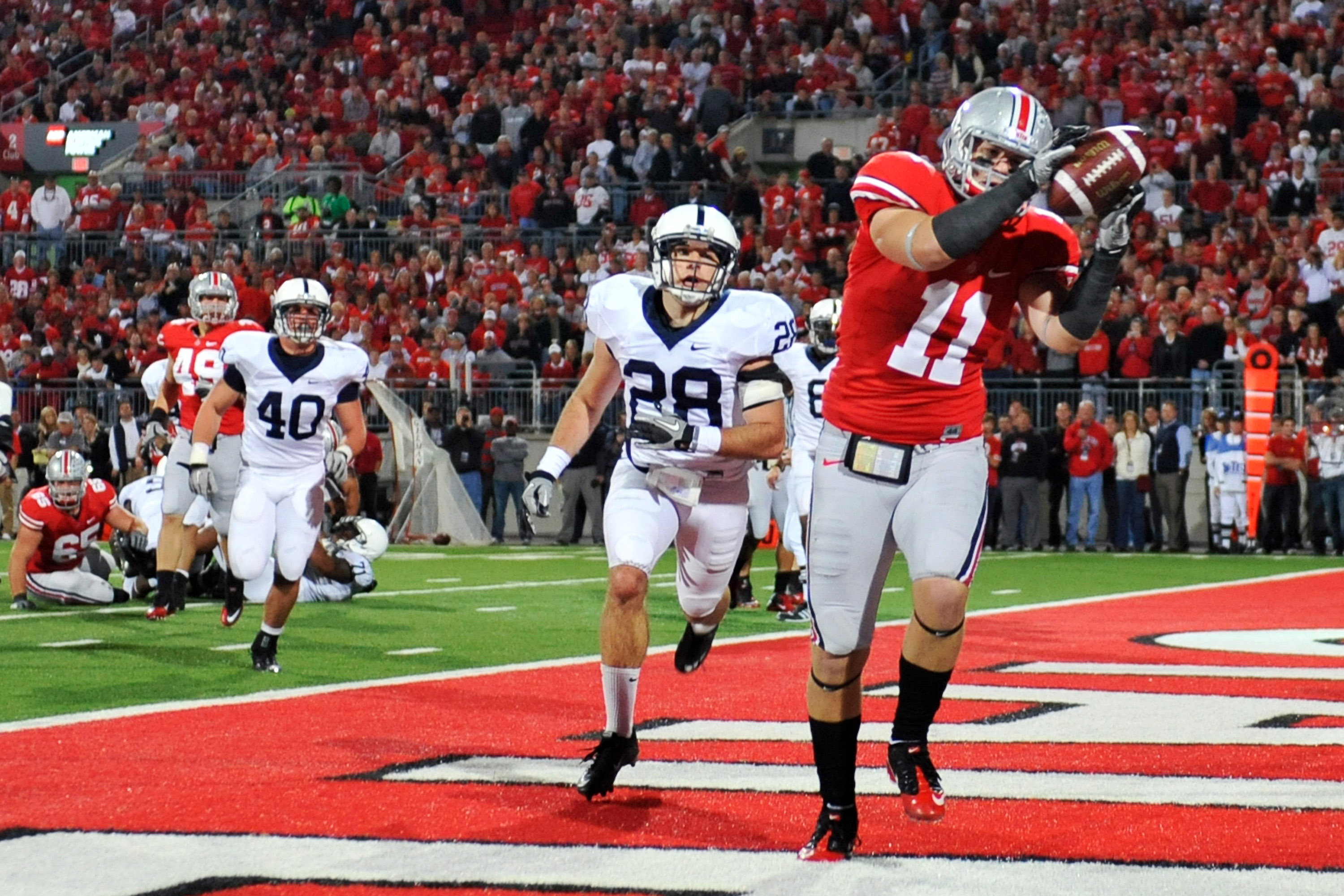 COLUMBUS, OH - NOVEMBER 13:  Jake Stoneburner #11 of the Ohio State Buckeyes makes a three yard touchdown reception in front of Drew Astorino #28 of the Penn State Nittany Lions at Ohio Stadium on November 13, 2010 in Columbus, Ohio. Ohio State defeated P