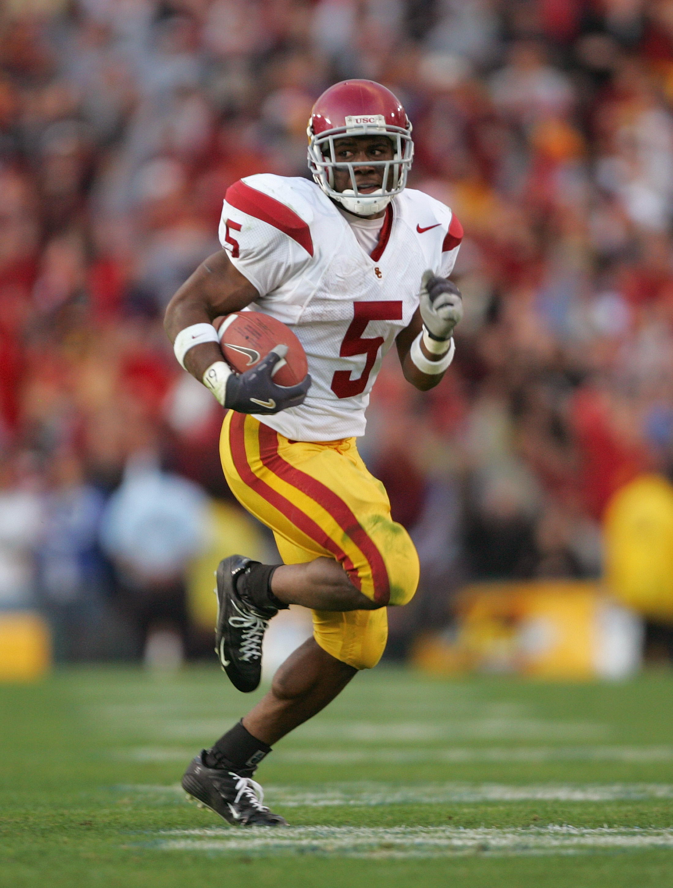 PASADENA, CA - DECEMBER 4:  Reggie Bush #5 of the USC Trojans carries the ball during the game against the UCLA Bruins on December 4, 2004 at the Rose Bowl in Pasadena, California.  USC won 29-24. (Photo by Harry How/Getty Images)