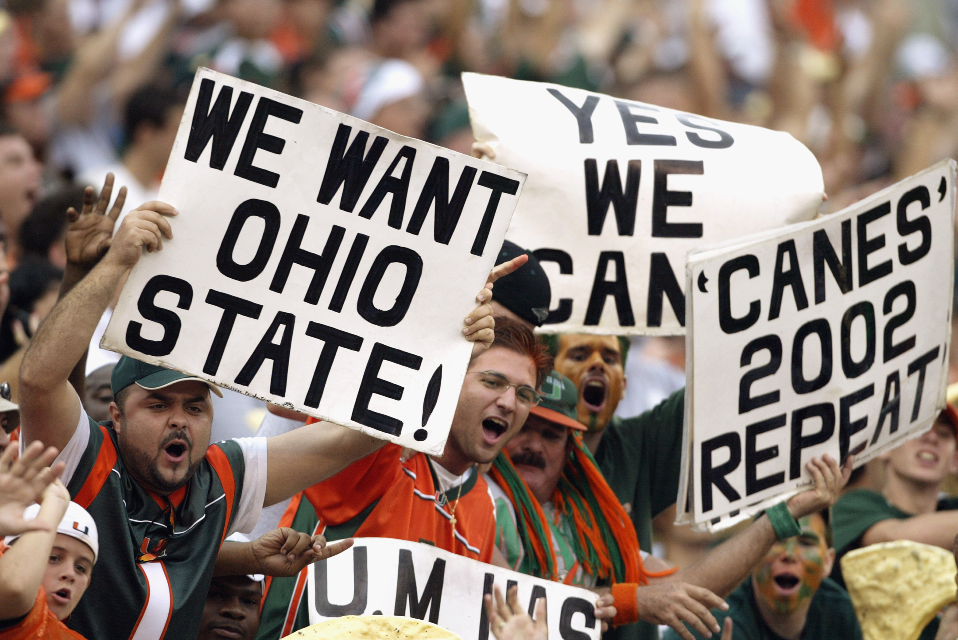 MIAMI - DECEMBER 7:  Fans of the University of Miami Hurricanes want their team to take on the Ohio State University Buckeyes during the game against the Virginia Polytechnic Institute and State University Hokies at the Orange Bowl on December 7, 2002 in