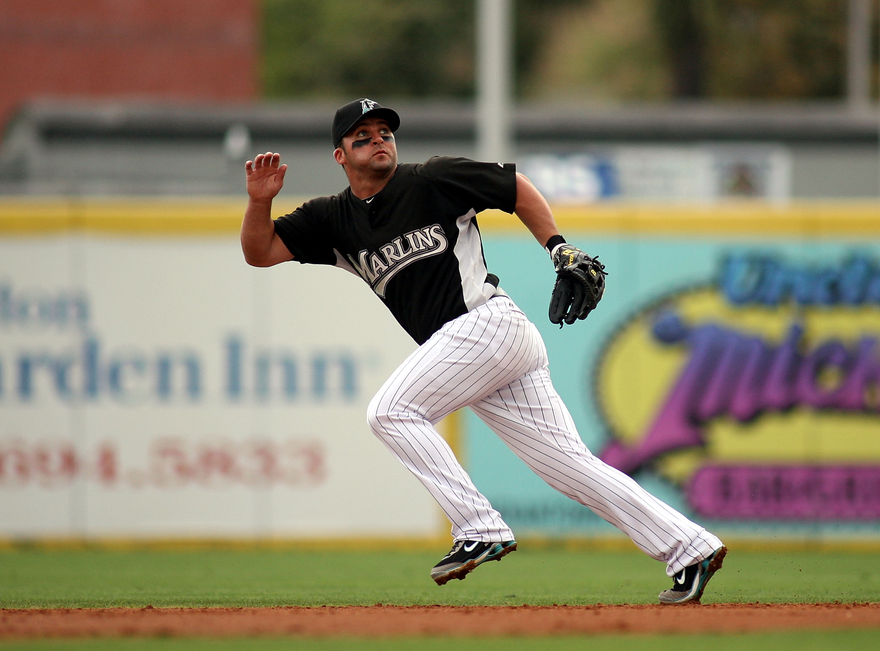JUPITER, FL - MARCH 28: Second baseman Dan Uggla #6 of the Florida Marlins moves towards the ball  against the Houston Astros on March 28, 2010 at Roger Dean Stadium in Jupiter, Florida.  (Photo by Marc Serota/Getty Images)