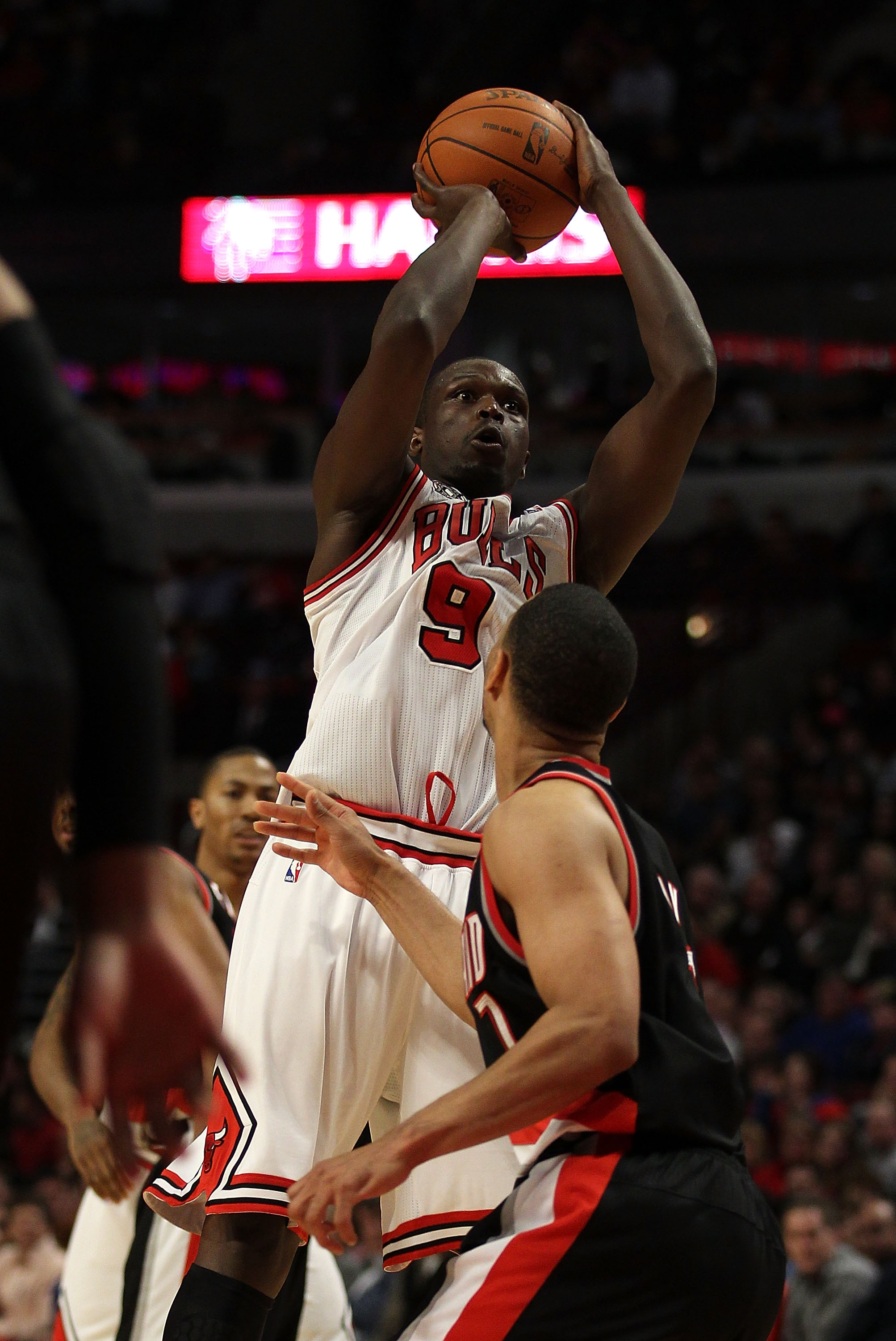 CHICAGO - NOVEMBER 01: Loul Deng #9 of the Chicago Bulls puts up a shot over Brandon Roy #7 of the Portland Trail Blazers on his way to a game-high 40 points at the United Center on November 1, 2010 in Chicago, Illinois. The Bulls defeated the Trail Blaze