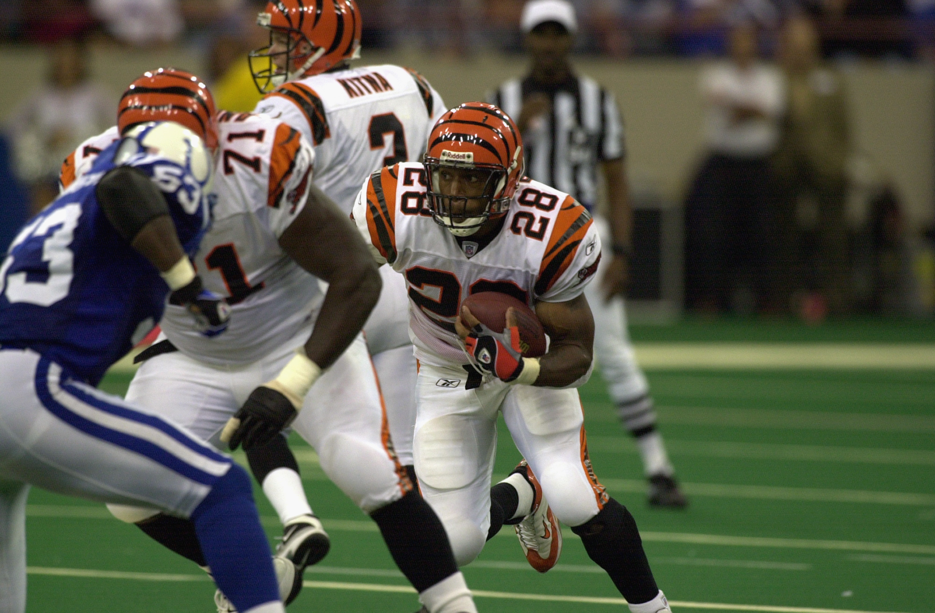 INDIANAPOLIS - OCTOBER 6:  Running back Corey Dillon #28 of the Cincinnati Bengals runs with the ball during the NFL game against the Indianapolis Colts at the RCA Dome on October 6, 2002 in Indianapolis, Indiana. The Colts defeated the Bengals 28-21. (Ph