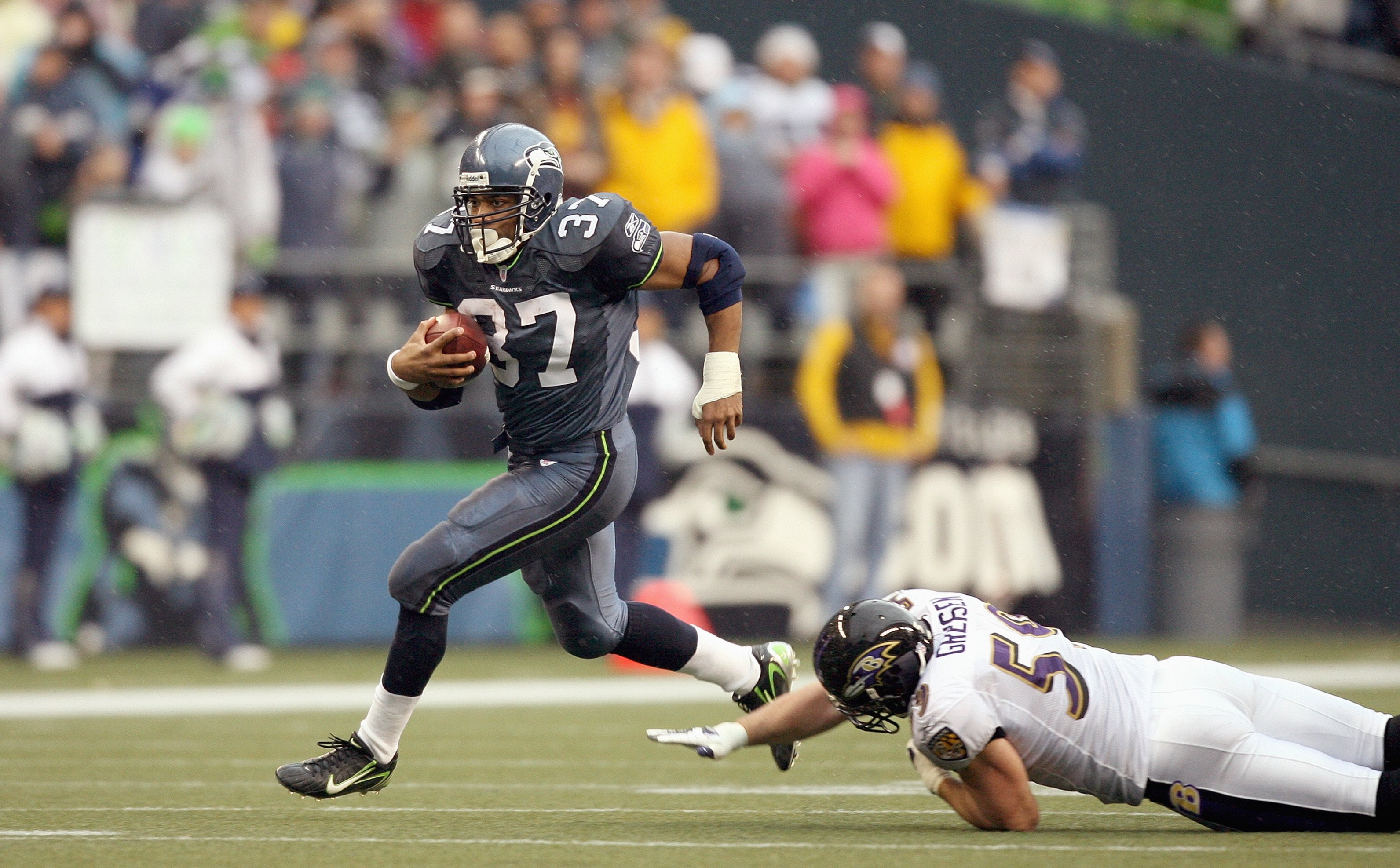 SEATTLE - DECEMBER 23: Shaun Alexander #37 of the Seattle Seahawks runs the ball during the game against the Baltimore Ravens at Qwest Field on December 23, 2007 in Seattle, Washington. The Seahawks defeated the Ravens 27-6. (Photo by Otto Greule Jr/Getty