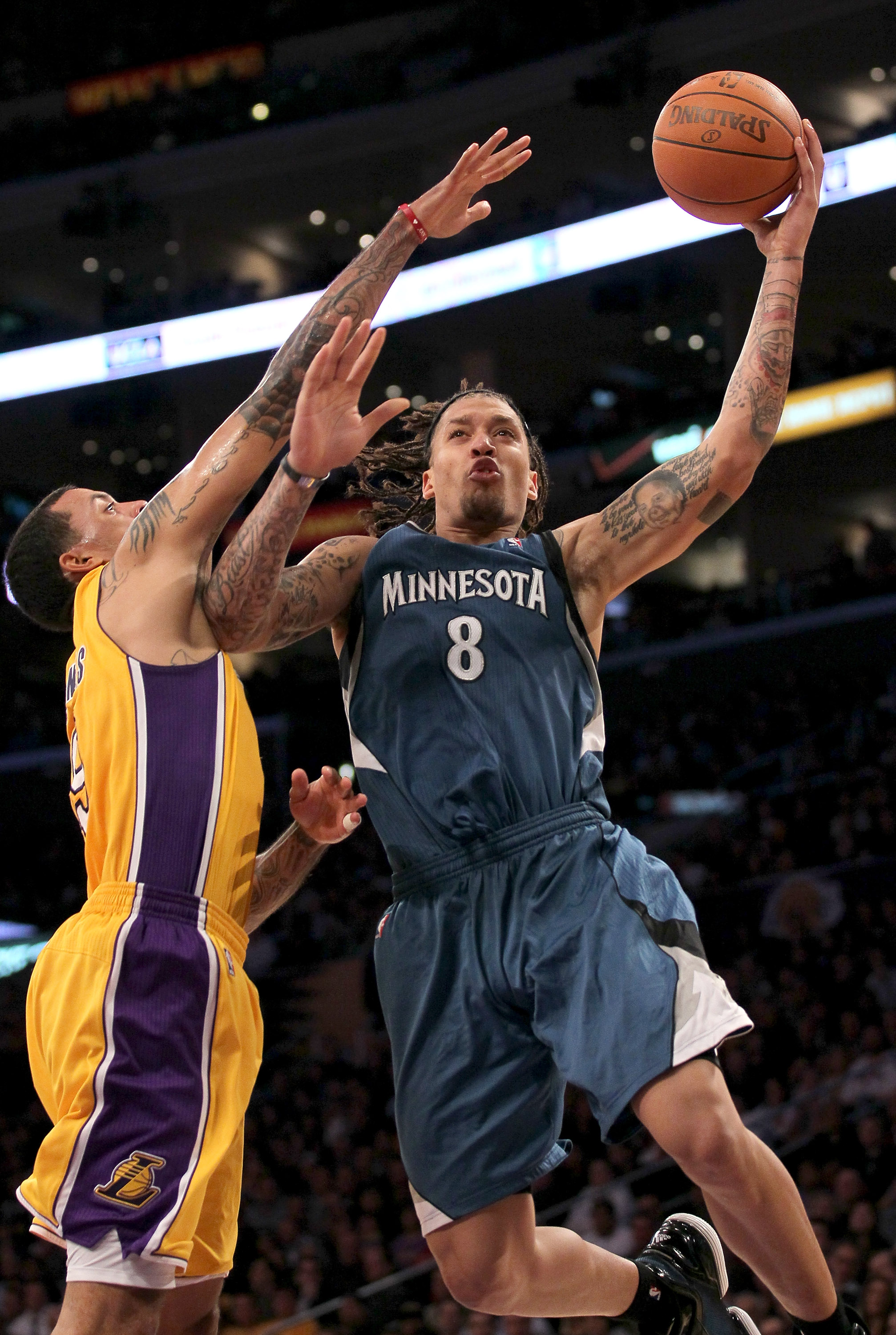 LOS ANGELES - NOVEMBER 9: Michael Beasley #8 of the Minnesota Timberwolves goes up for a shot against Matt Barnes #9 of the Los Angeles Lakers at Staples Center on November 9, 2010 in Los Angeles, California. The Lakers won 99-94.   NOTE TO USER: User exp