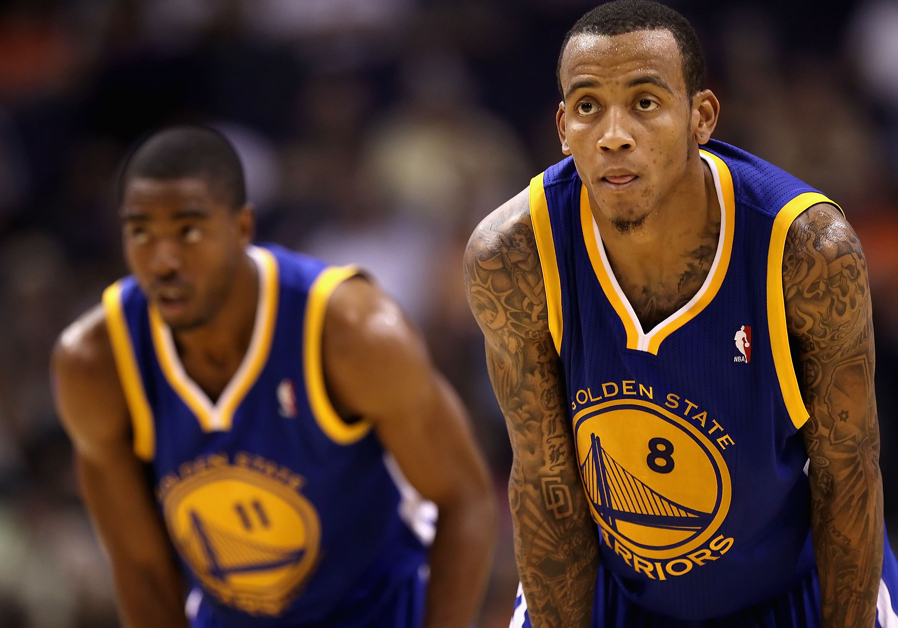 PHOENIX - OCTOBER 19:  Monta Ellis #8 (R) and Aaron Miles #11 of the Golden State Warriors await a free throw shot against the Phoenix Suns during the preseason NBA game at US Airways Center on October 19, 2010 in Phoenix, Arizona. NOTE TO USER: User expr