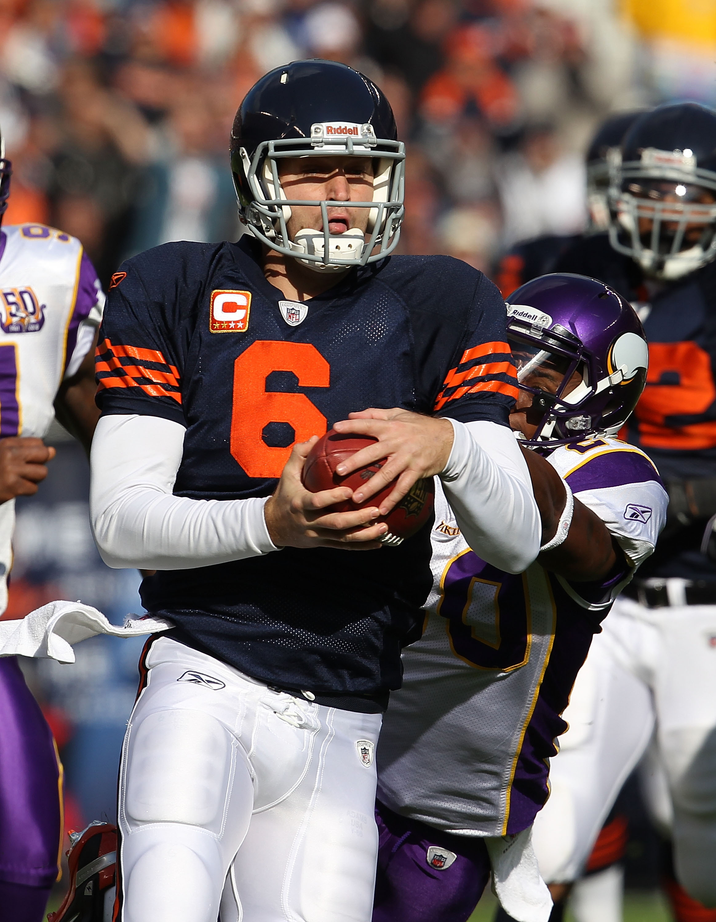 CHICAGO - NOVEMBER 14: Jay Cutler #6 of the Chicago Bears breaks away from Madieu Williams #20 of the Minnesota Vikings as his runs for a first down at Soldier Field on November 14, 2010 in Chicago, Illinois. The Bears defeated the Vikings 27-13.  (Photo