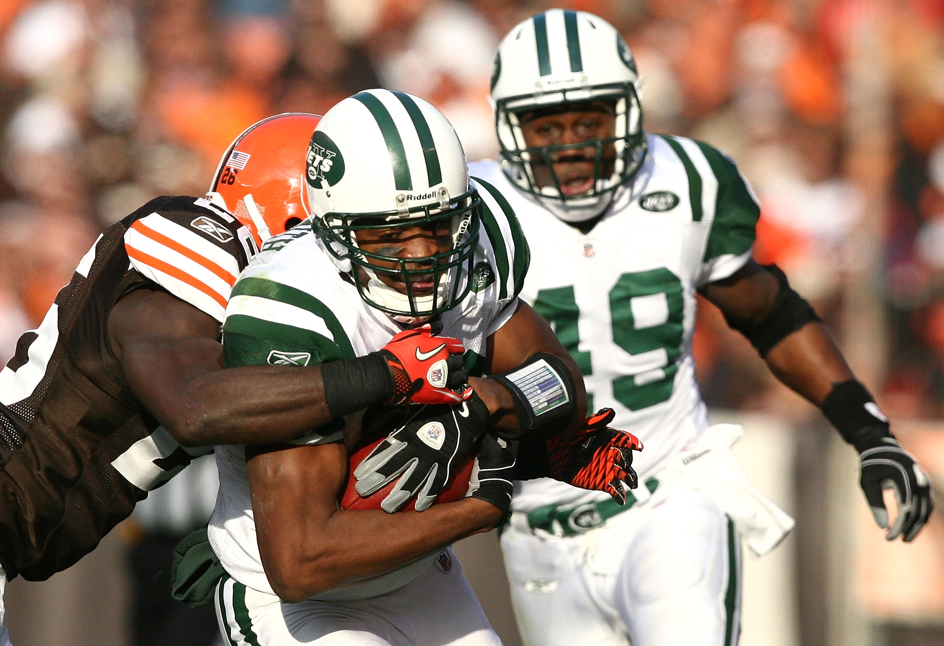 CLEVELAND - NOVEMBER 14:  Wide receiver Brad Smith #16 of the New York Jets is hit by defensive back Abram Elam #26 of the Cleveland Browns as Tony Richardson #49 looks on at Cleveland Browns Stadium on November 14, 2010 in Cleveland, Ohio.  (Photo by Mat