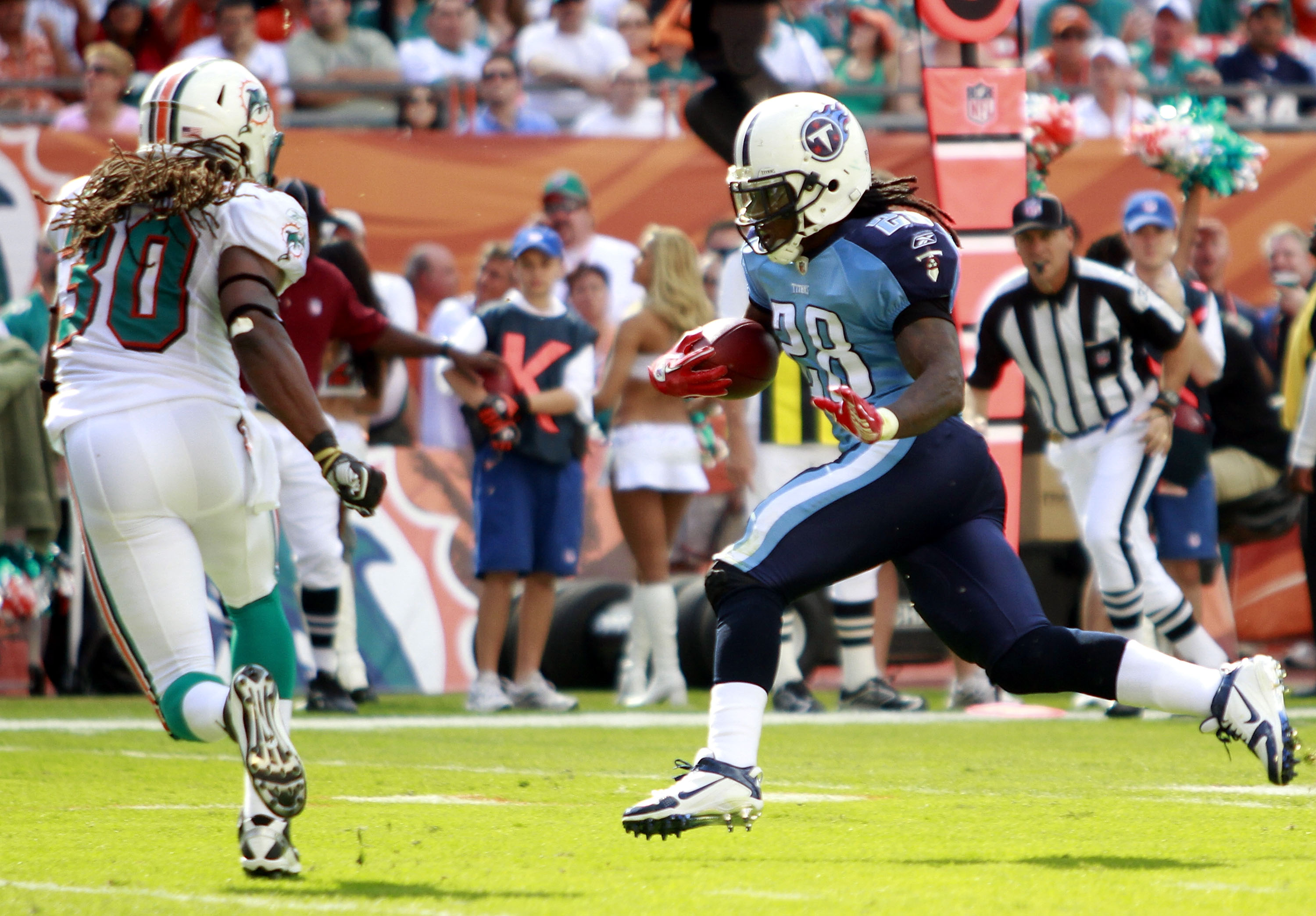 MIAMI - NOVEMBER 14:  Running back Chris Johnson #28 of the Tennessee Titans scores a touchdown  against Chris Clemons #30 of the Miami Dolphins at Sun Life Stadium on November 14, 2010 in Miami, Florida.  (Photo by Marc Serota/Getty Images)