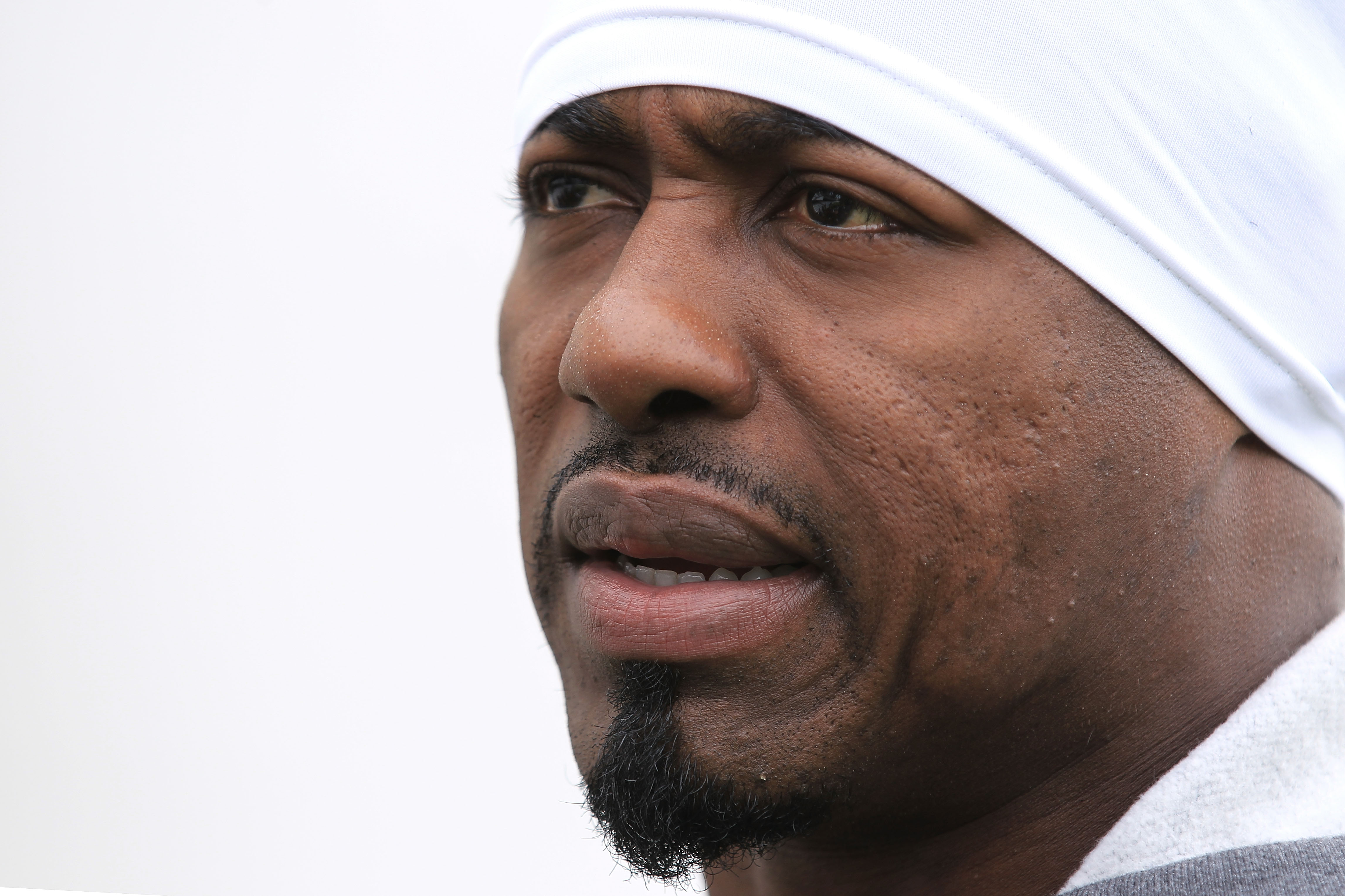 LONDON, ENGLAND - OCTOBER 29:  Brian Dawkins of the Denver Broncostalks to the media prior to the start of a team training session at The Brit Oval on October 29, 2010 in London, England. The Denver Broncos will play the San Francisco 49ers at Wembley Sta