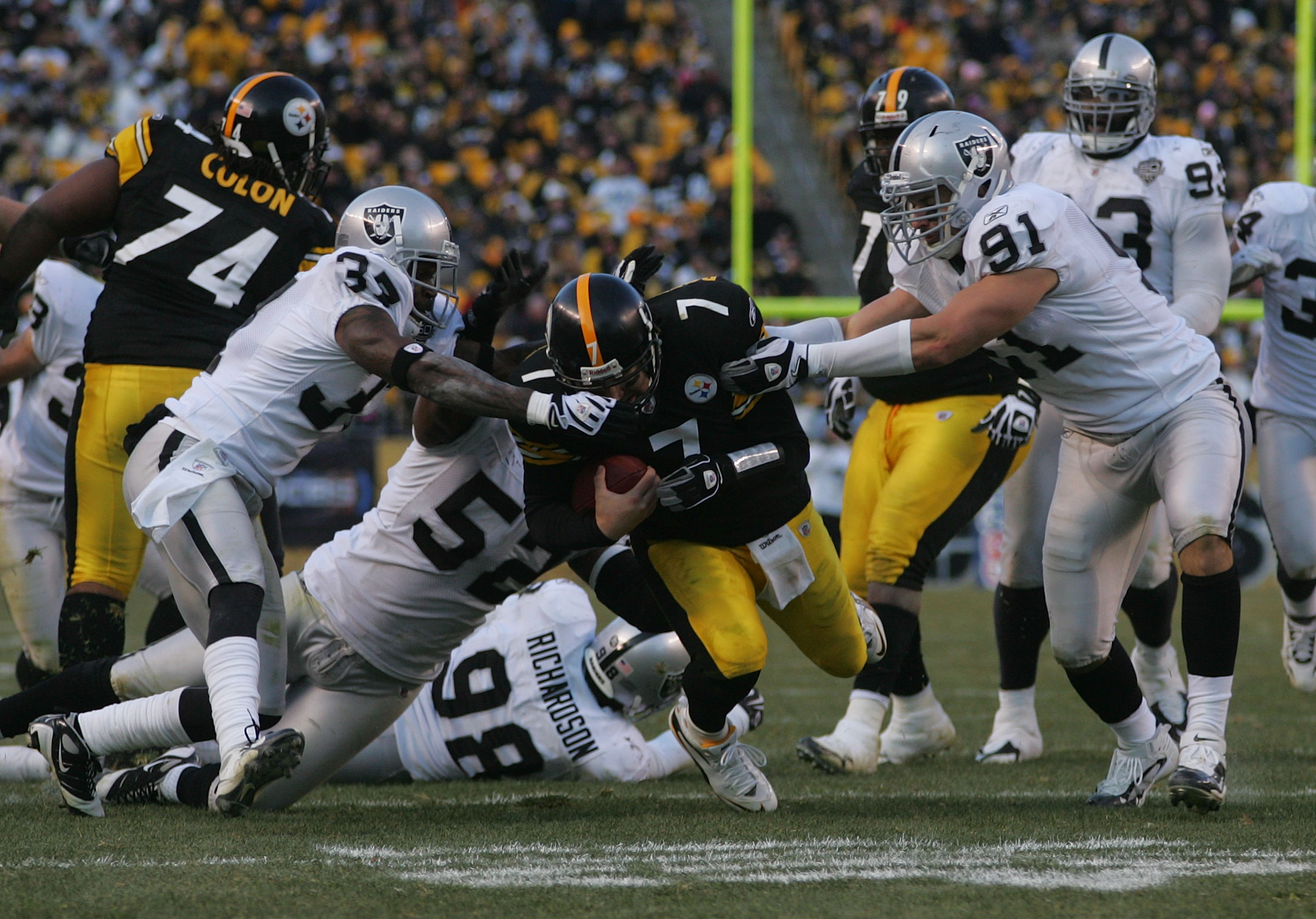 PITTSBURGH - DECEMBER 6: Ben Roethlisberger #7 of the Pittsburgh Steelers runs with the ball against the Oakland Raiders in the fourth quarter during the game on December 6, 2009 at Heinz Field in Pittsburgh, Pennsylvania. (Photo by Jared Wickerham/Getty