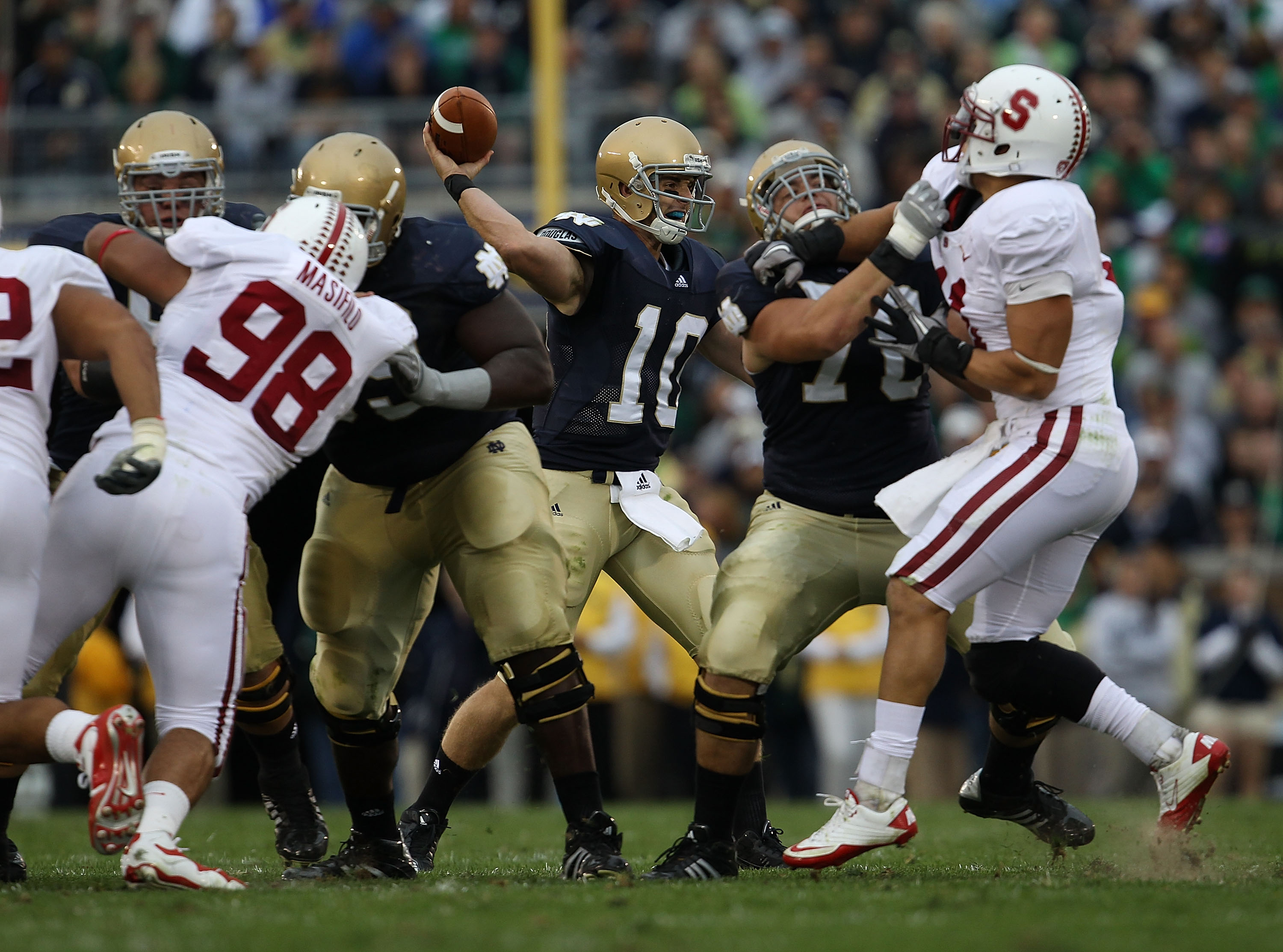 SOUTH BEND, IN - SEPTEMBER 25: Dayne Crist #10 of the Notre Dame Fighting Irish passes the ball against the Stanford Cardinal at Notre Dame Stadium on September 25, 2010 in South Bend, Indiana. Stanford defated Notre Dame 37-14. (Photo by Jonathan Daniel/