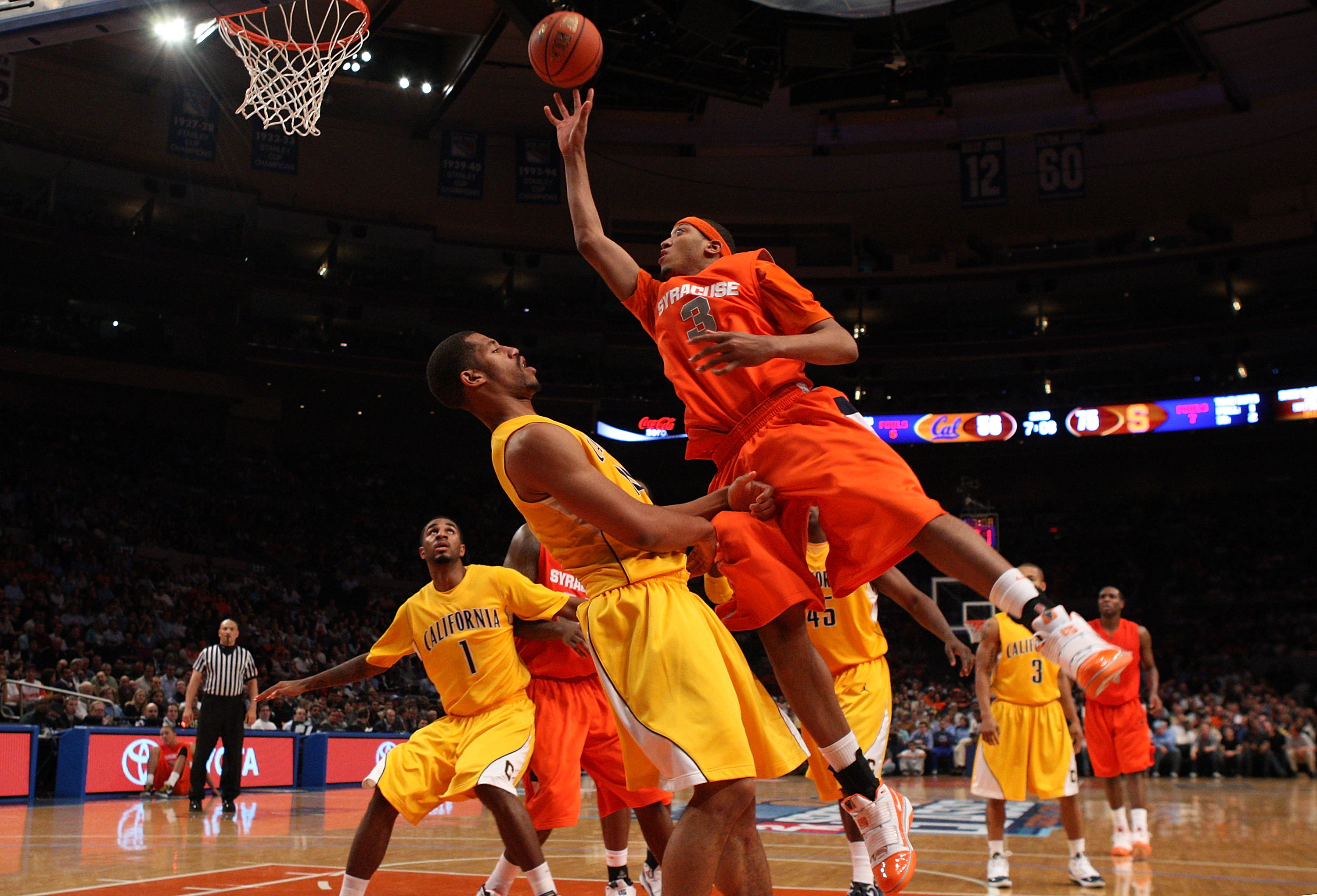 NEW YORK - NOVEMBER 19:  Mookie Jones #3 of the Syracuse Orange lays up a basket against the California Golden Bears during their semifinal game of the 2K Sports Classic on  November 19, 2009 at Madison Square Garden in New York City.  (Photo by Jim McIsa